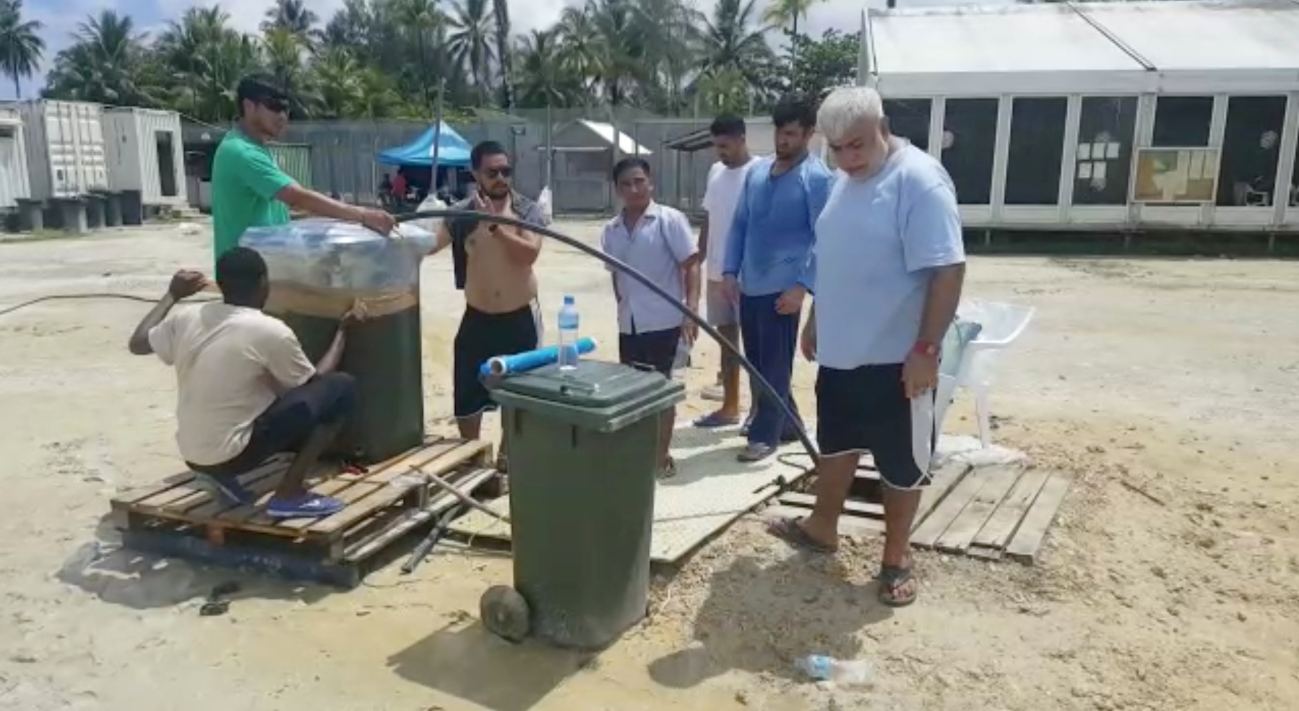 Asylum seekers detained on Manus Island modify a man-made well on Nov. 3, 2017.