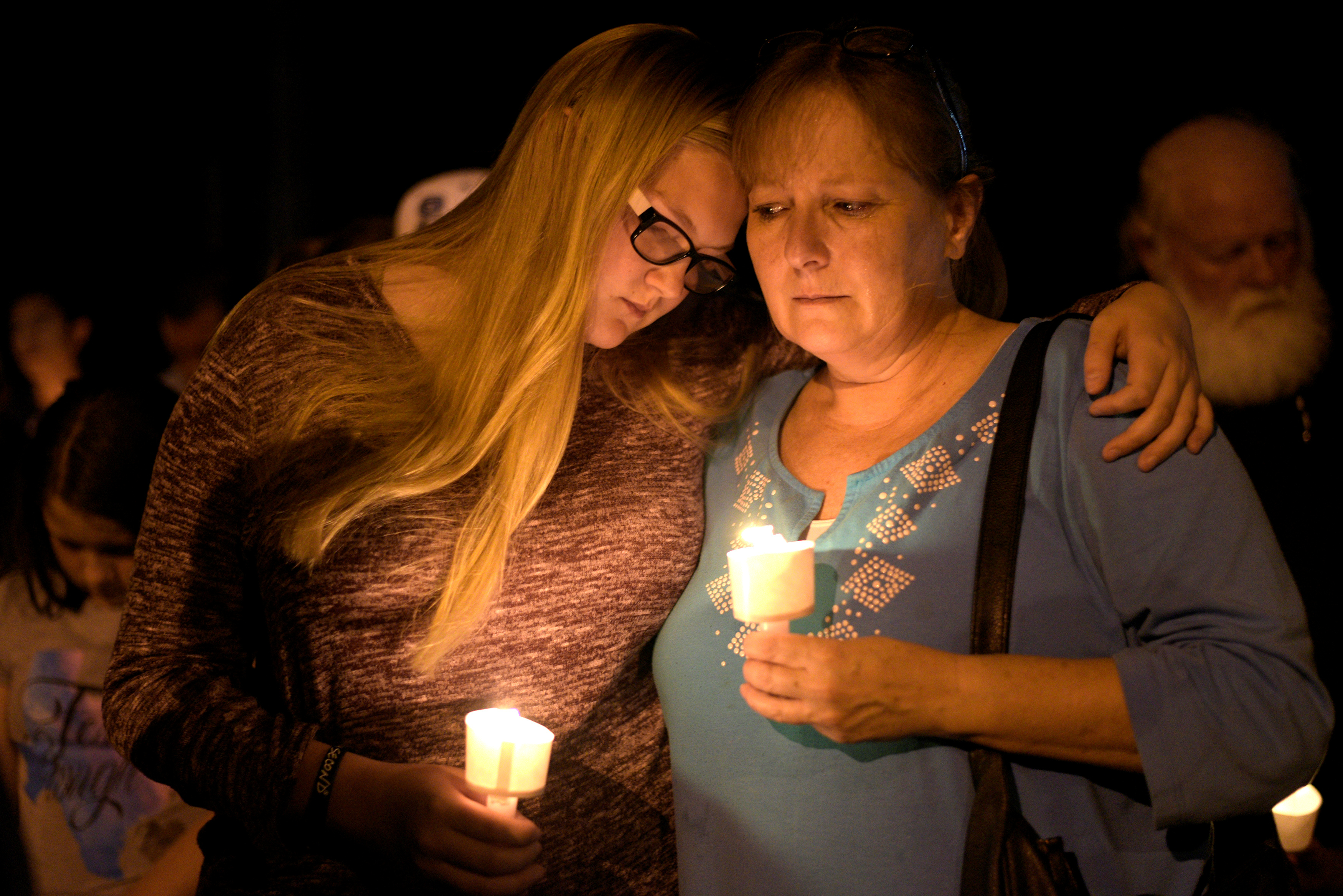 Terri and Brooke Kalinec attend a candle light vigil after a mass shooting at the First Baptist Church in Sutherland Springs, Texas, Nov. 5, 2017.