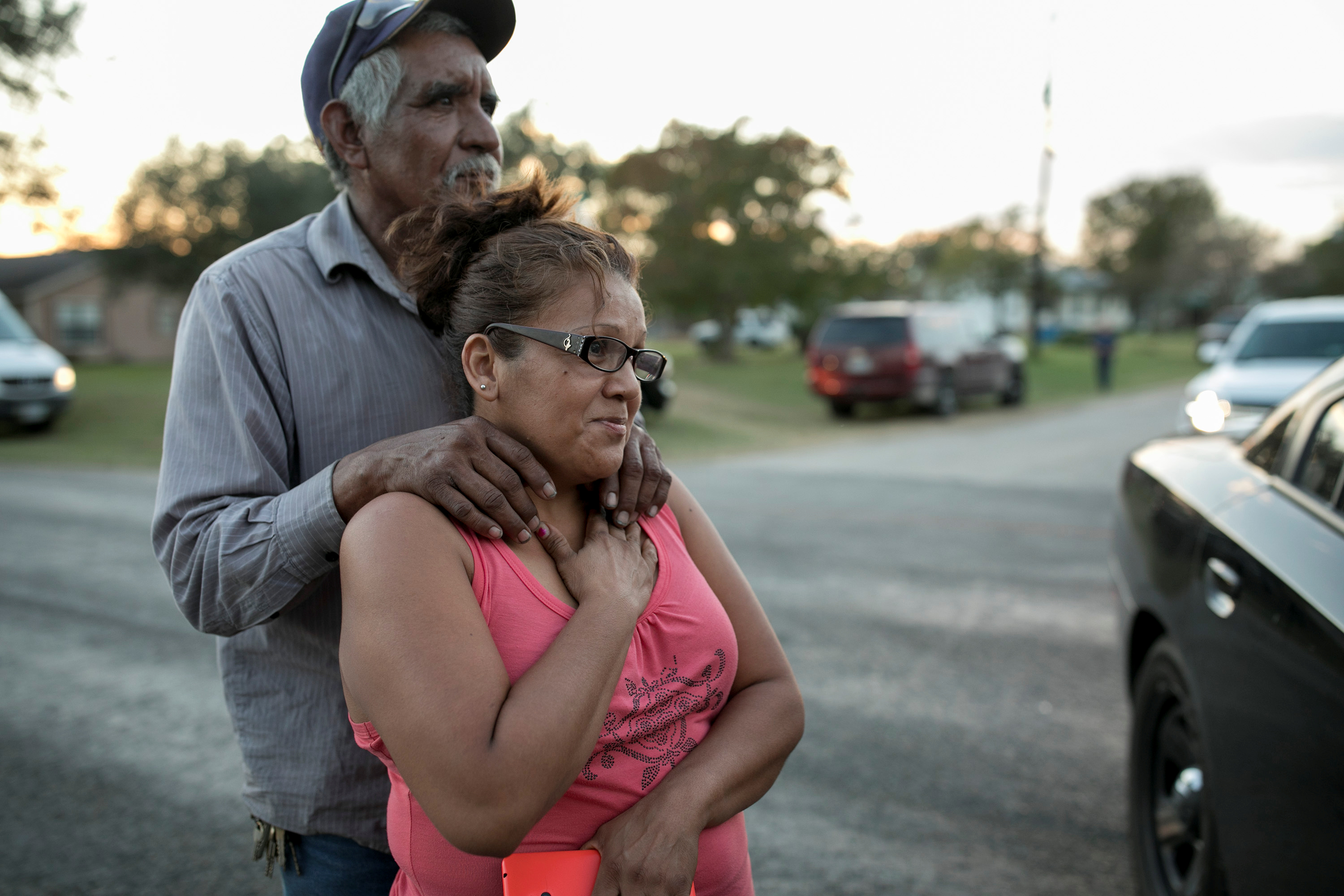 Enrique and Gabby Garcia watch as law enforcement officers investigate a mass shooting at the First Baptist Church in Sutherland Springs, Texas, Nov. 5, 2017.