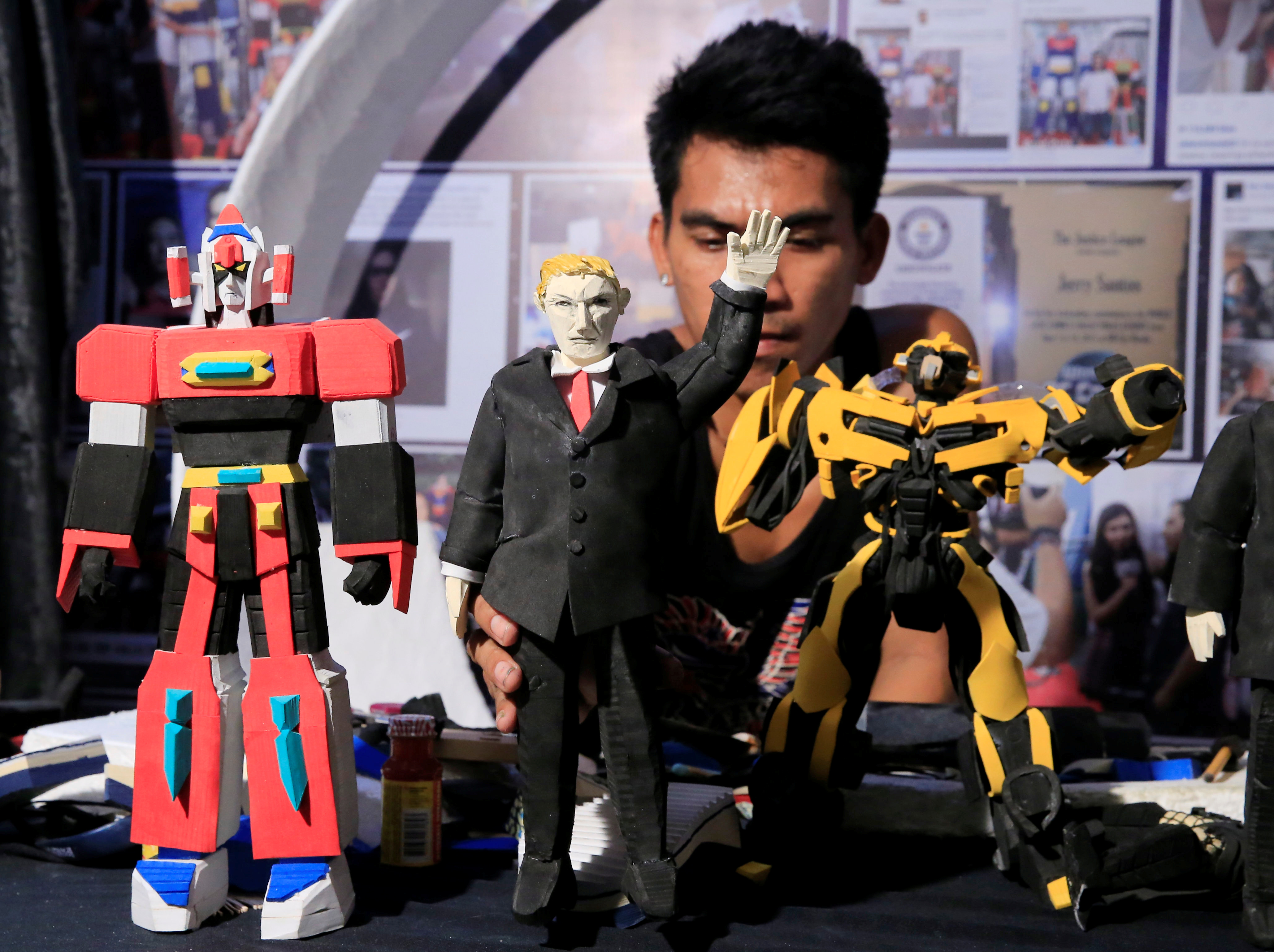 Elmer Padilla, 30, makes a figure of President Donald Trump at his workshop in Manila, Philippines, Nov. 8, 2017.