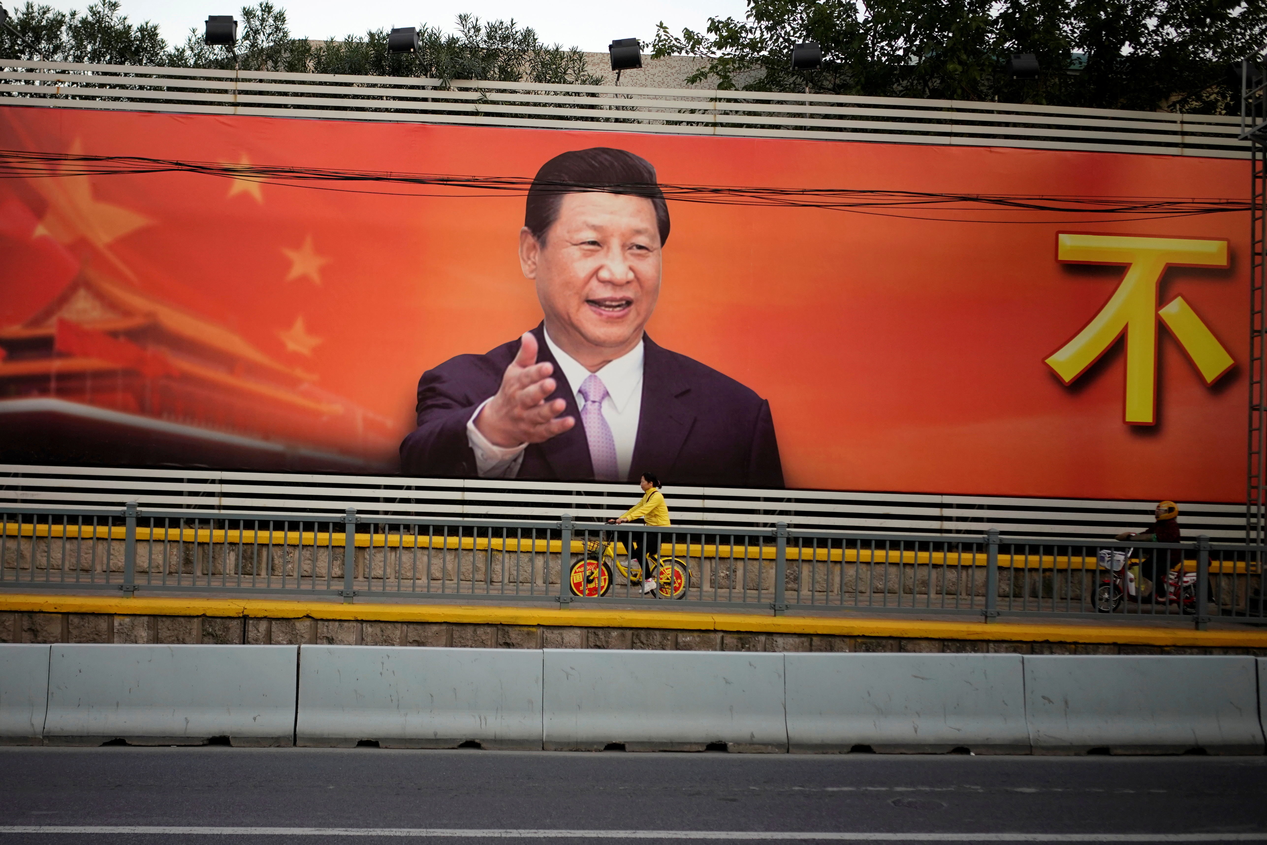 A poster with a portrait of Chinese President Xi Jinping is displayed along a street in Shanghai, China, October 24, 2017.