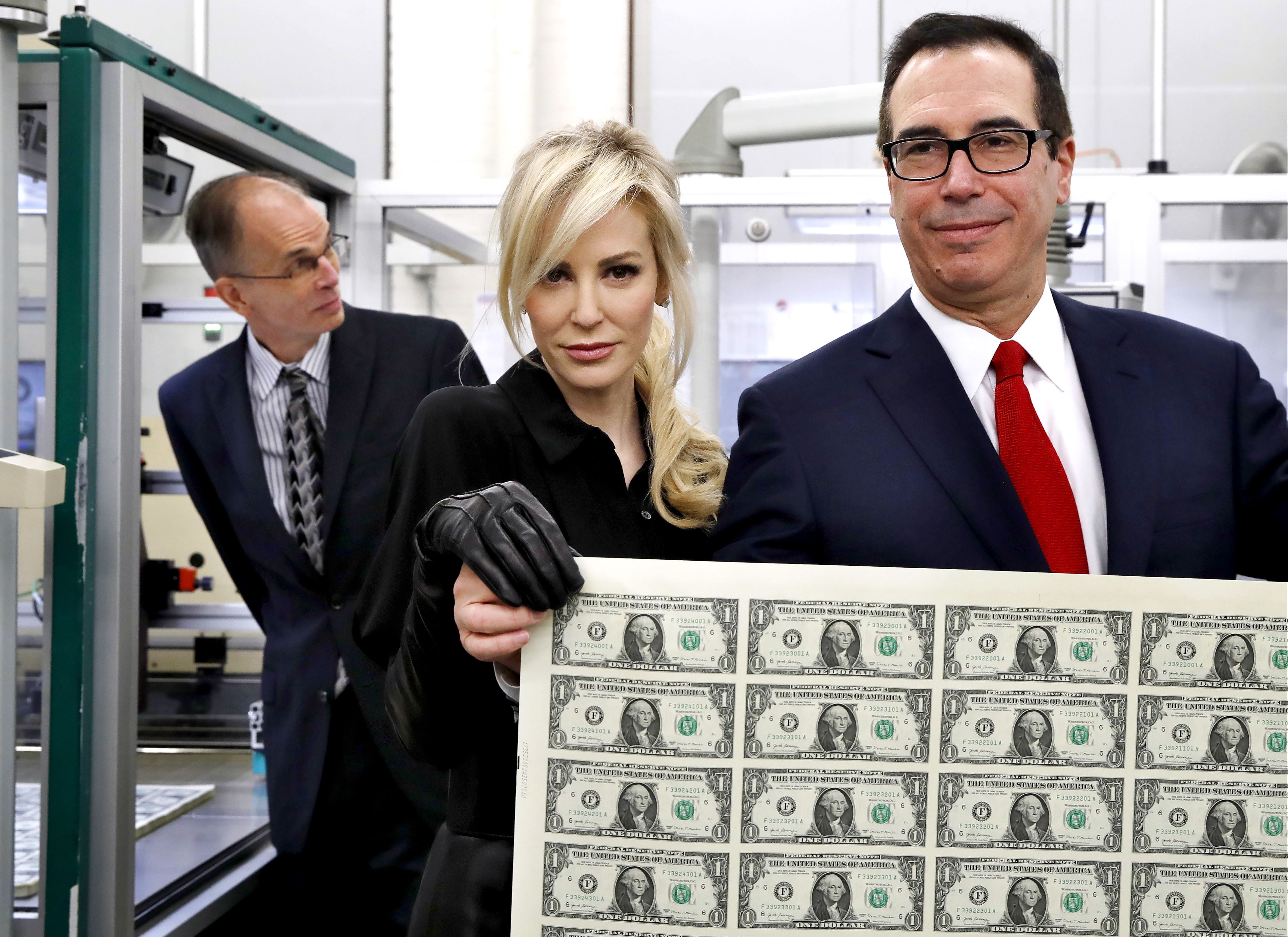 When Treasury Secretary Steven Mnuchin and his wife Louise Linton stopped by the Bureau of Engraving and Printing, they were photographed checking out $1 bills. The wire photos of the pair holding a sheet of dollars - the first currency notes bearing his and U.S. Treasurer Jovita Carranza's signatures - just made the parody too easy.                      It predictably and instantly became a flash point for online fun and comedian Andy Richter's joking tweet about it got 14,000 likes.