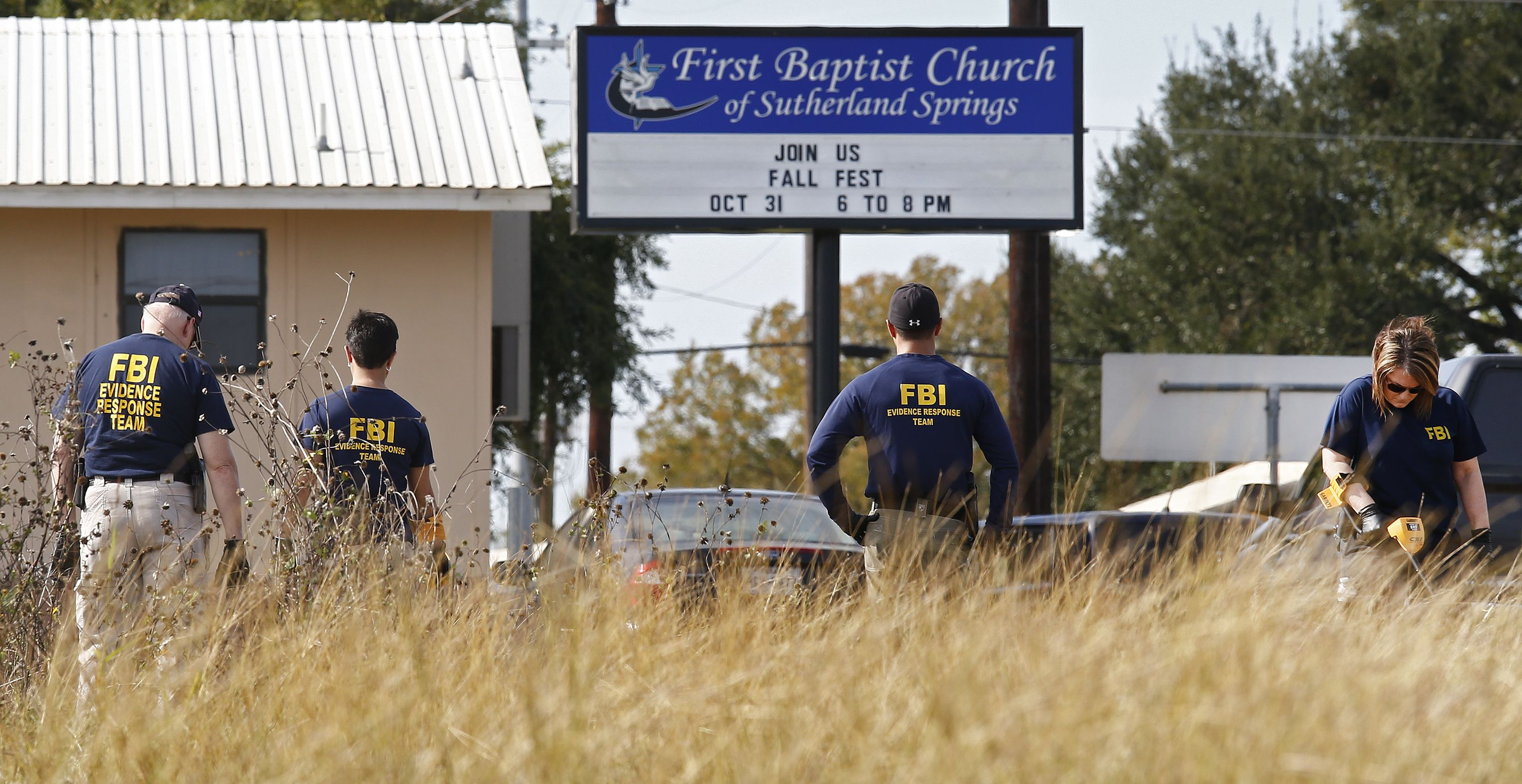 Members of the FBI and investigators search the scene of a mass shooting at the First Baptist Church in Sutherland Springs, Texas, on Nov. 6, 2017