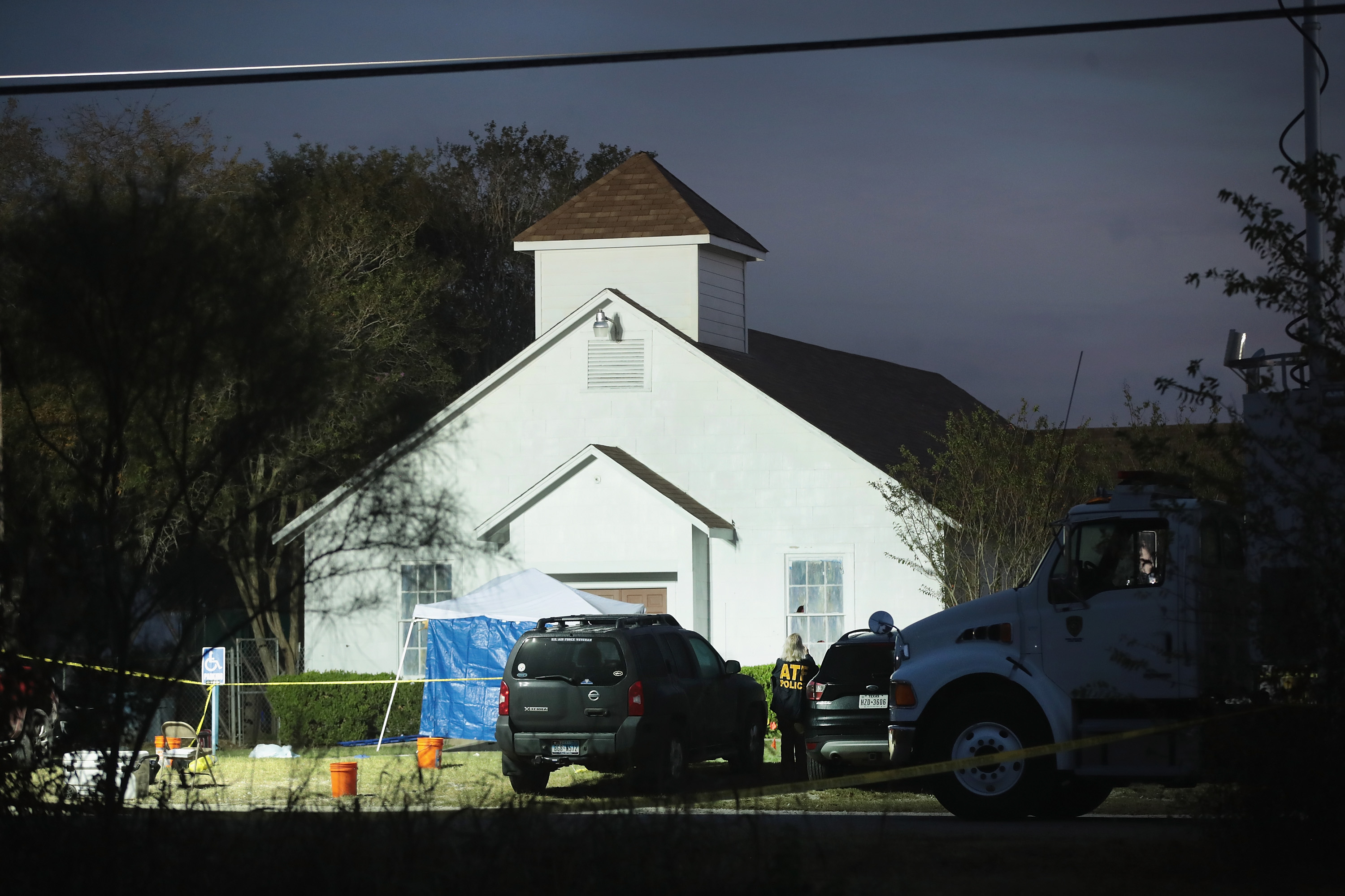 SUTHERLAND SPRINGS, TX - NOVEMBER 06:  Law enforcement officials continue their investigation at First Baptist Church of Sutherland Springs as the sun begins to rise on November 6, 2017 in Sutherland Springs, Texas. Yesterday a gunman, Devin Patrick Kelley, killed 26 people at the church and wounded many more when he opened fire during a Sunday service.  (Photo by Scott Olson/Getty Images)