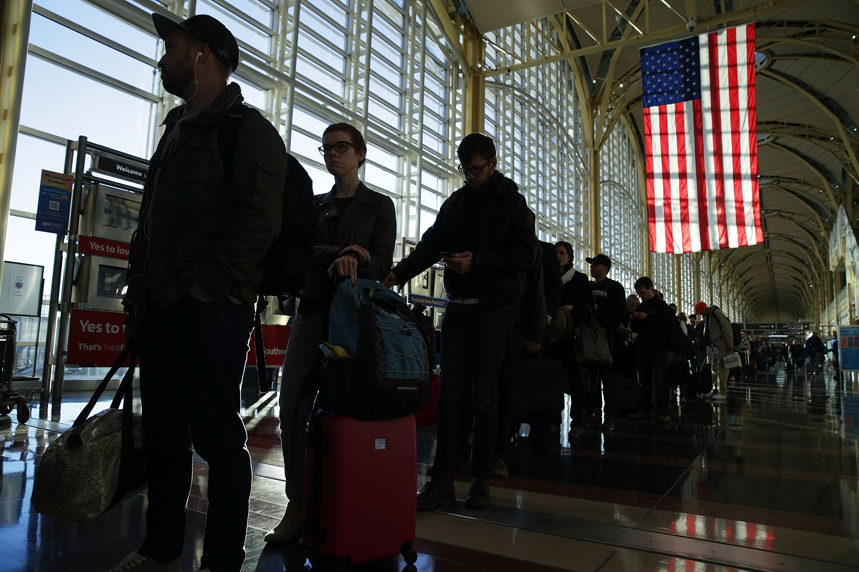 Travelers wait in-line for entering security check at Ronald Reagan Washington National Airport November 23, 2016 in Arlington, Virginia. AAA has predicted that it will be more crowded than usual to travel this Thanksgiving with nearly 49 million Americans driving or flying to their destinations