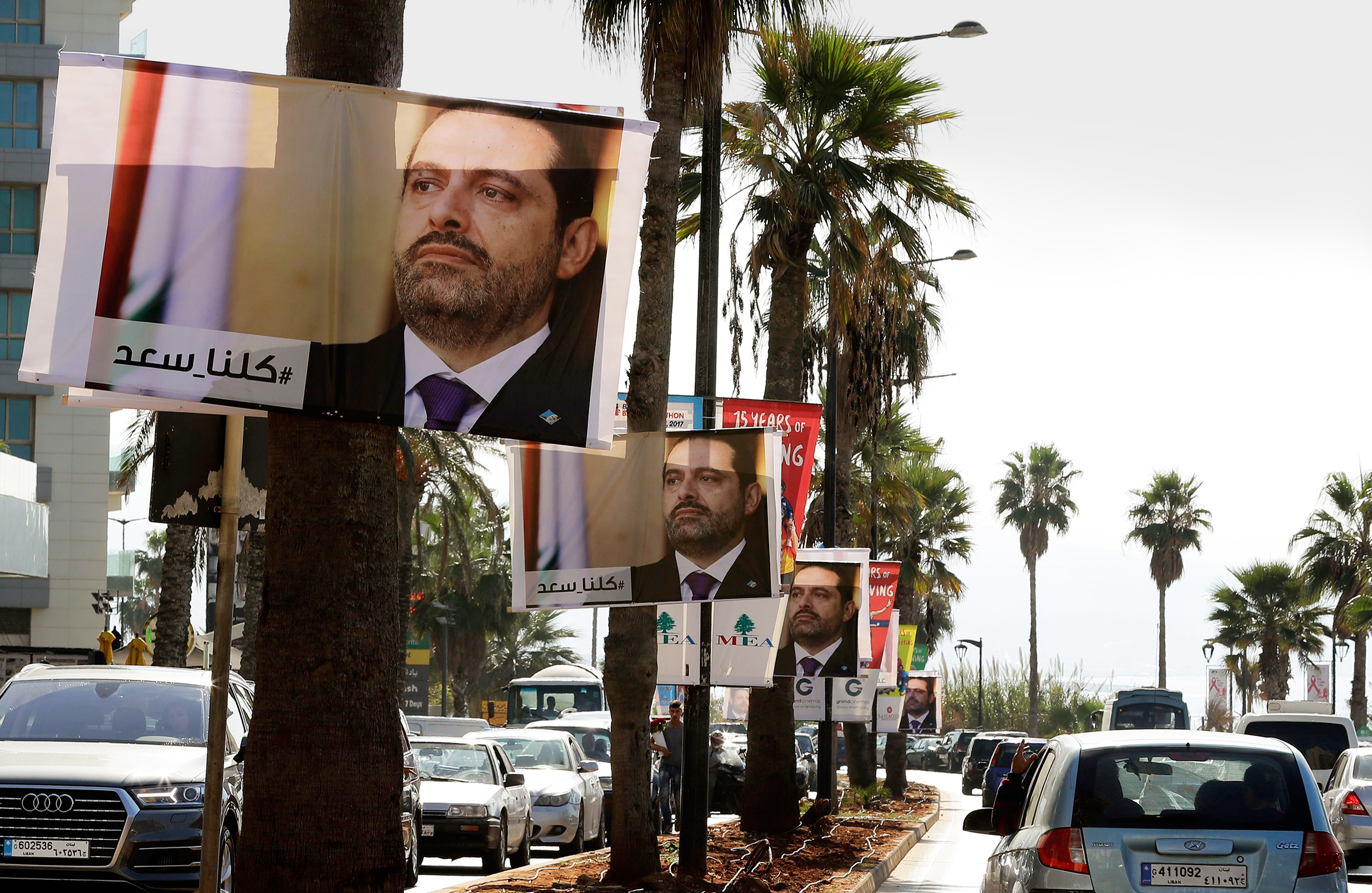 Posters of Lebanon's leader Saad Hariri with the caption #We_are_all_Saad in Beirut on Nov. 10Hariri's announced resignation sparked concerns of a political crisis in Lebanon as tensions between Saudi Arabia and Iran escalated. / AFP PHOTO / JOSEPH EIDJOSEPH EID/AFP/Getty Images