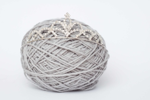 Grey ball of yarn with a tiara