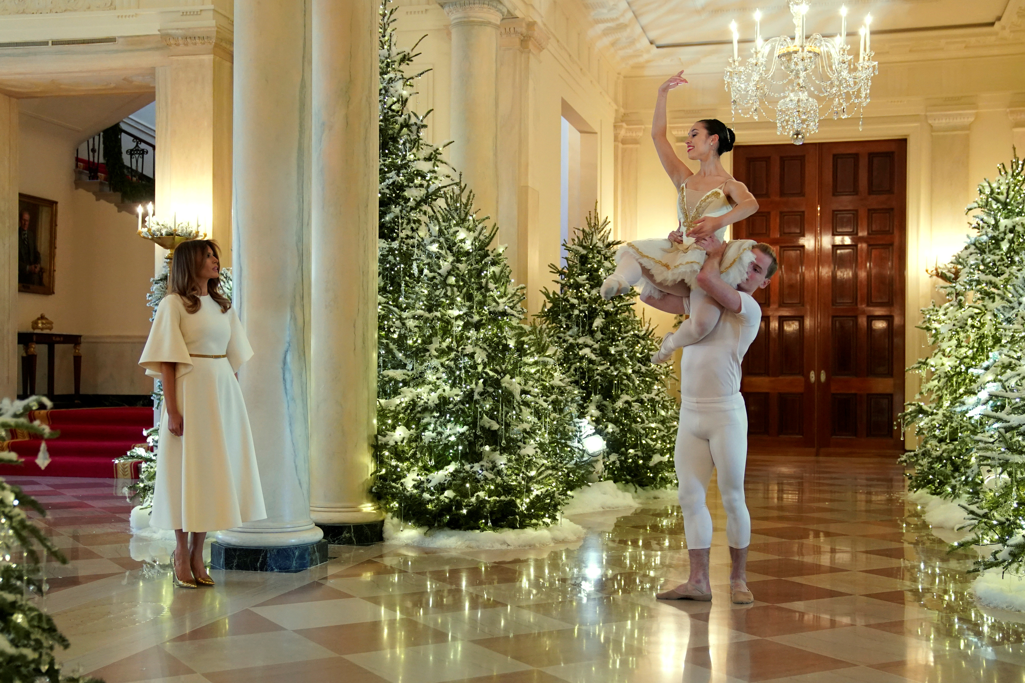 Ballet dancers perform as U.S. first lady Melania Trump begins a tour of the holiday decorations with reporters at the White House in Washington, D.C., Nov 27, 2017.