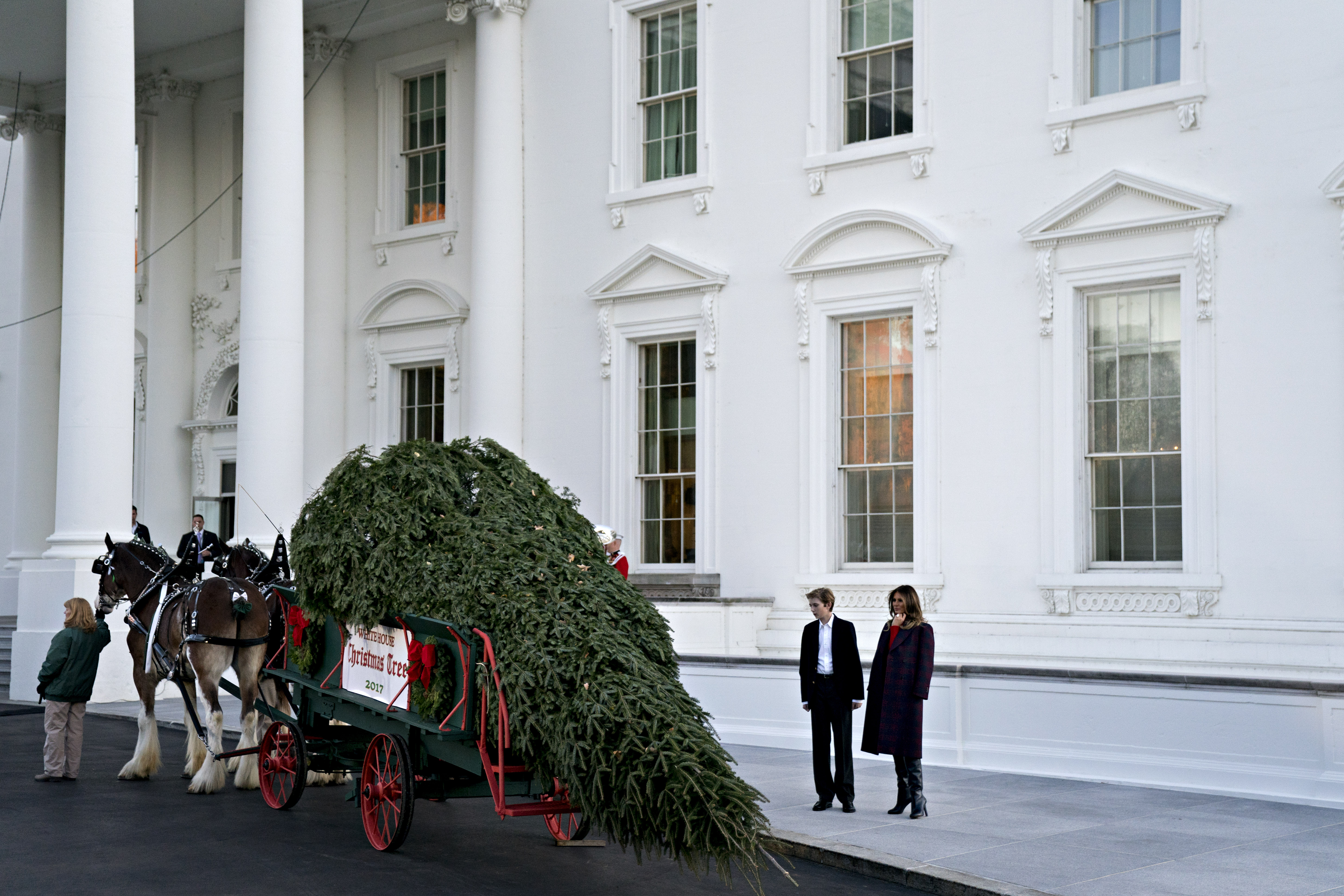 U.S. First Lady Melania Trump, right, and son Barron Trump view the White House Christmas Tree at the North Portico of the White House in Washington, D.C., on Nov. 20, 2017. Silent Night Evergreens presented the Wisconsin-grown Christmas Tree to Melania and the tree will be displayed in the White House Blue Room.
