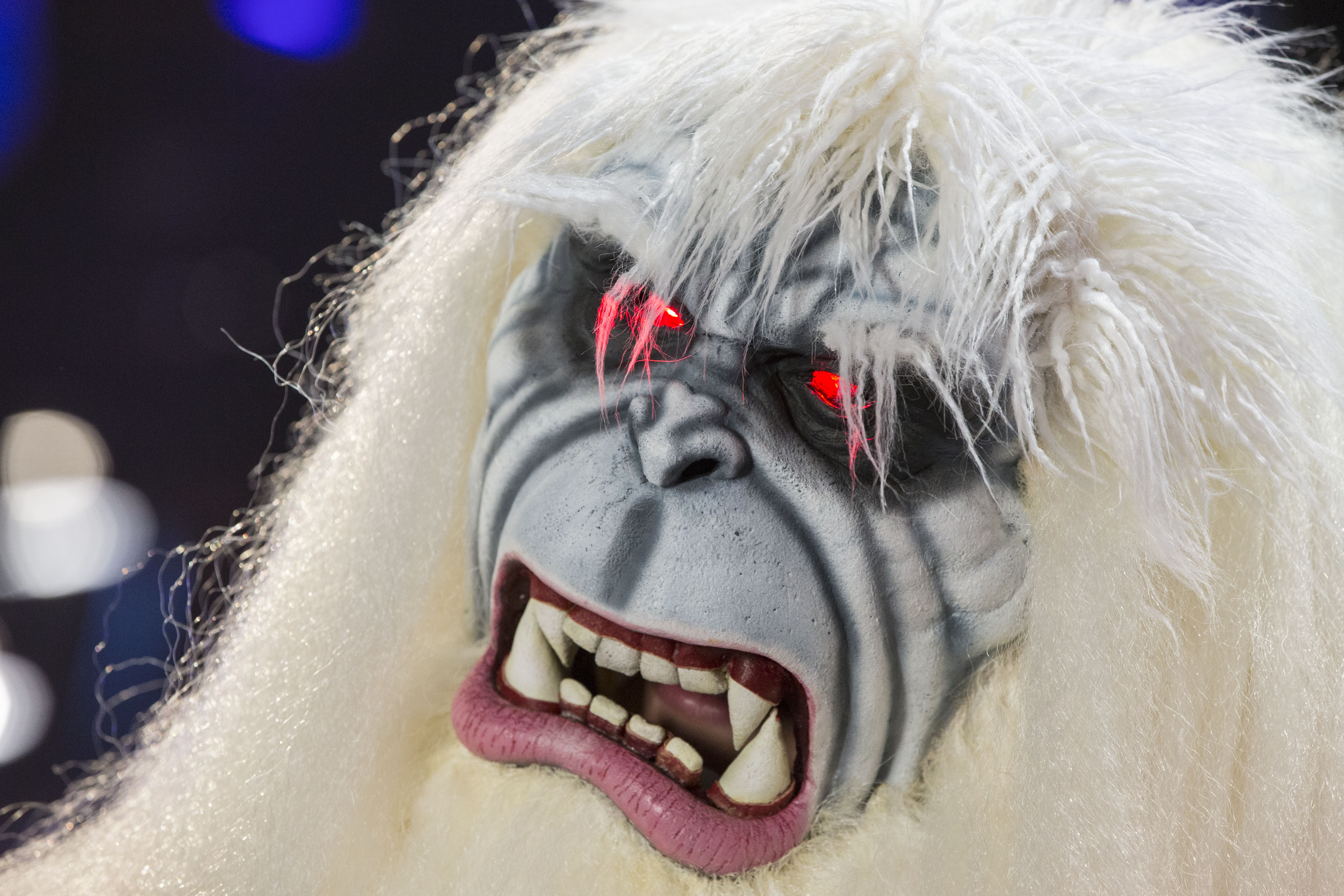 The eyes of an attendee dressed as a Yeti are illuminated after winning a costume contest during the D23 Expo 2015 in Anaheim, California, U.S., on Friday, Aug. 14, 2015. The D23 Expo 2015, presented by the Official Disney Fan Club, includes sneak peeks of upcoming films from The Walt Disney Studios, celebrity appearances, as well as a look at what's coming from Disney Parks and Resort. Photographer: Patrick T. Fallon/Bloomberg via Getty Images