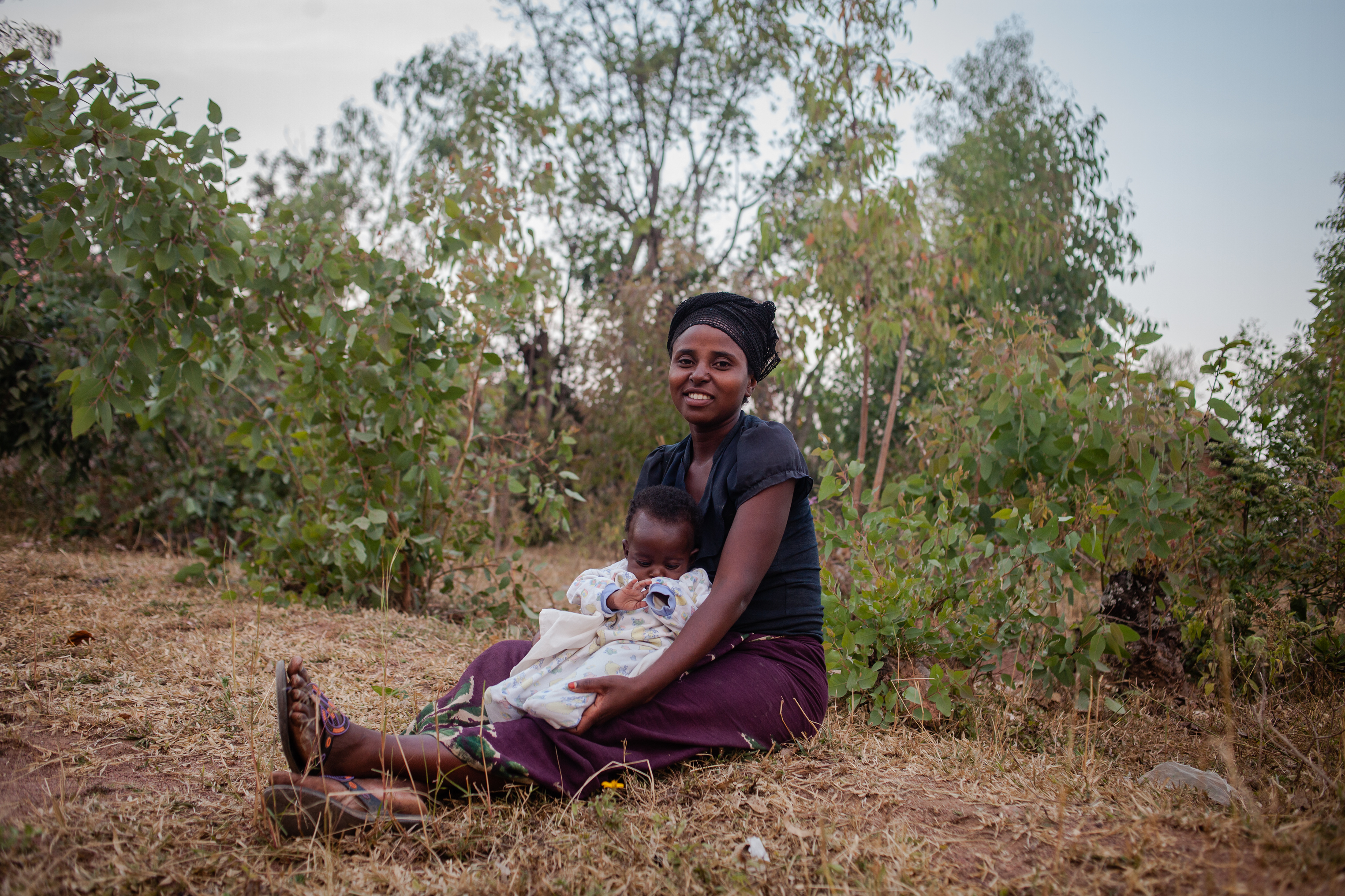 Claudine Ndashimye, 26, with her baby Rabertin. She received blood from Zipline after having complications with her pregnancy.