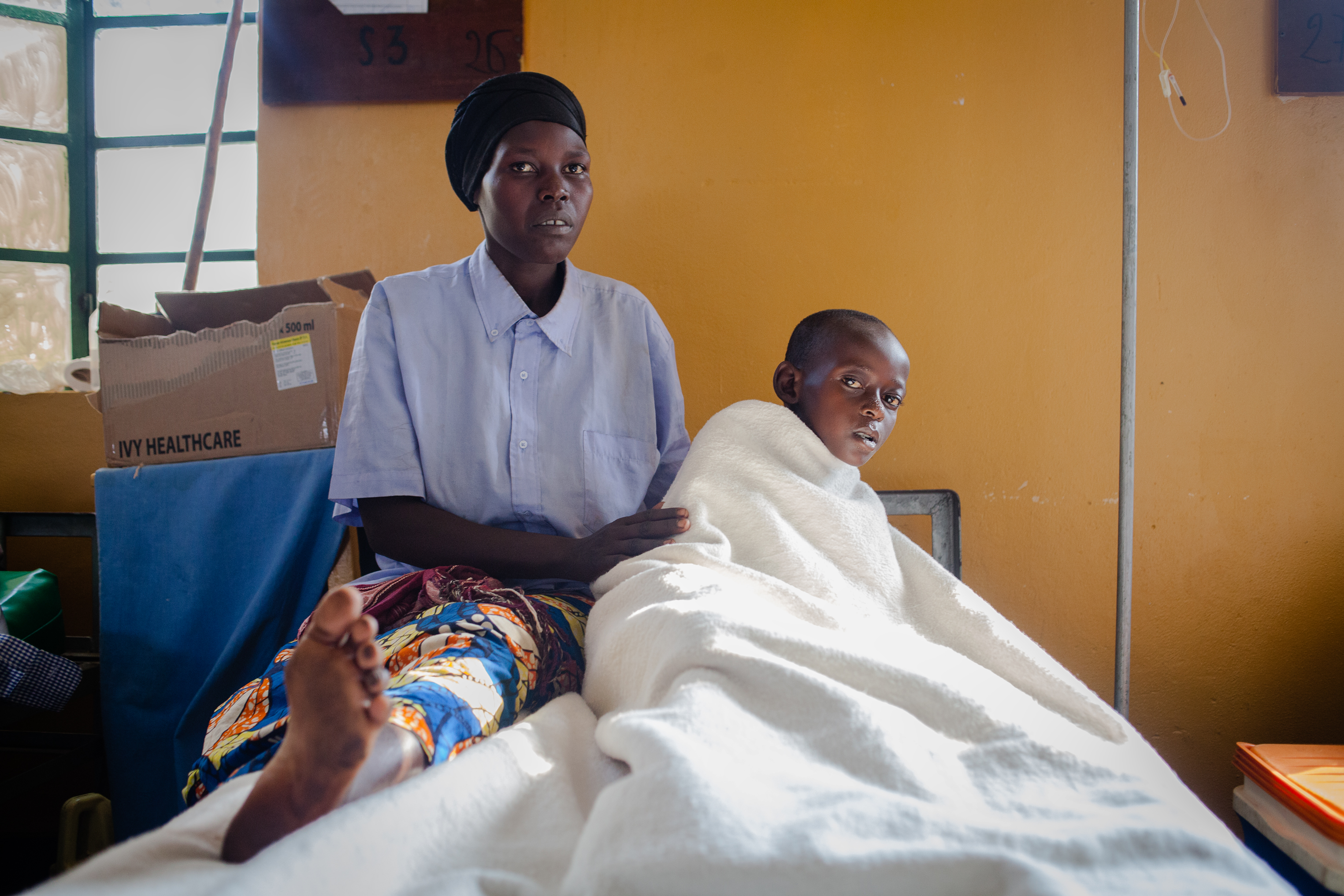 Donata Mubandakazi with her 10 year-old son Jean following surgery for an unidentified infection on his leg. He was given plasma from a Zipline drone.