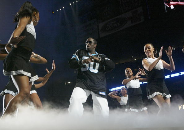Rapper Sean  P. Diddy  Combs performs during the halftime show at Super Bowl XXXVIII between the New England Patriots and the Carolina Panthers at Reliant Stadium in Houston, Texas  on February 1, 2004.