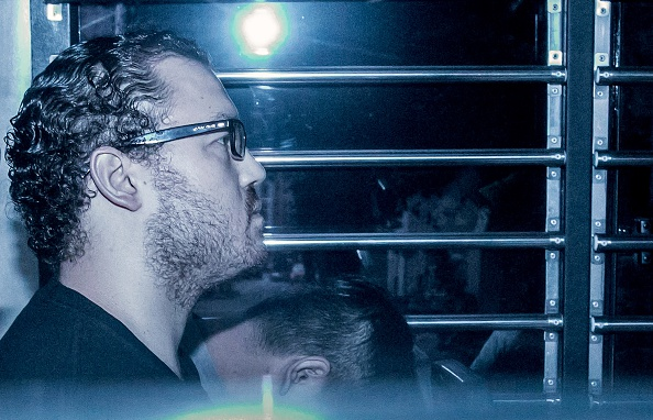 British banker Rurik Jutting accused of the murders of two Indonesian women, sits in a prison van as he arrives at the eastern court in Hong Kong on May 8, 2015.