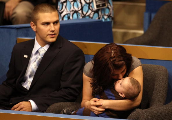 Track Palin sits with Willow Palin while holding Trig Palin on day three of the Republican National Convention (RNC) in St. Paul, Minnesota on September 3, 2008.