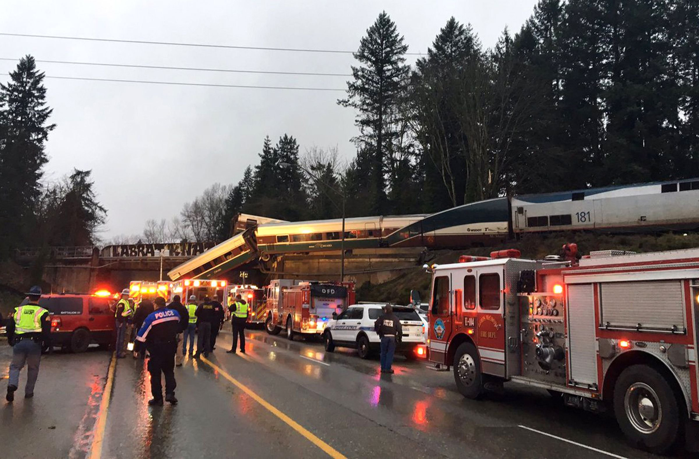 An Amtrak train that was derailed south of Seattle on Dec. 18, 2017. Authorities reported  injuries and casualties.  The train derailed about 40 miles (64 kilometers) south of Seattle before 8 a.m., spilling at least one train car on to busy Interstate 5.
