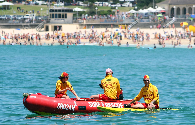 Lifeguards patrol the surf at Bondi Beach on December 25, 2010 in Sydney, Australia.