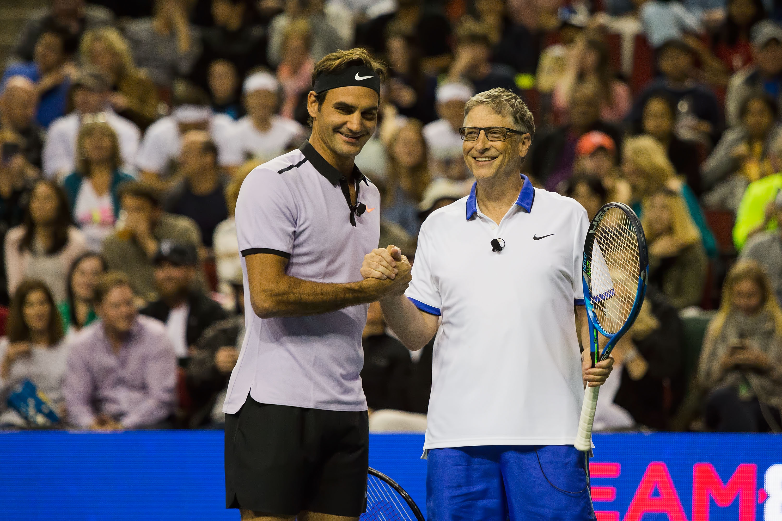 Roger Federer of Switzerland and Bill Gates shake hands at the Match For Africa 4 exhibition match at KeyArena on April 29, 2017 in Seattle, Washington.