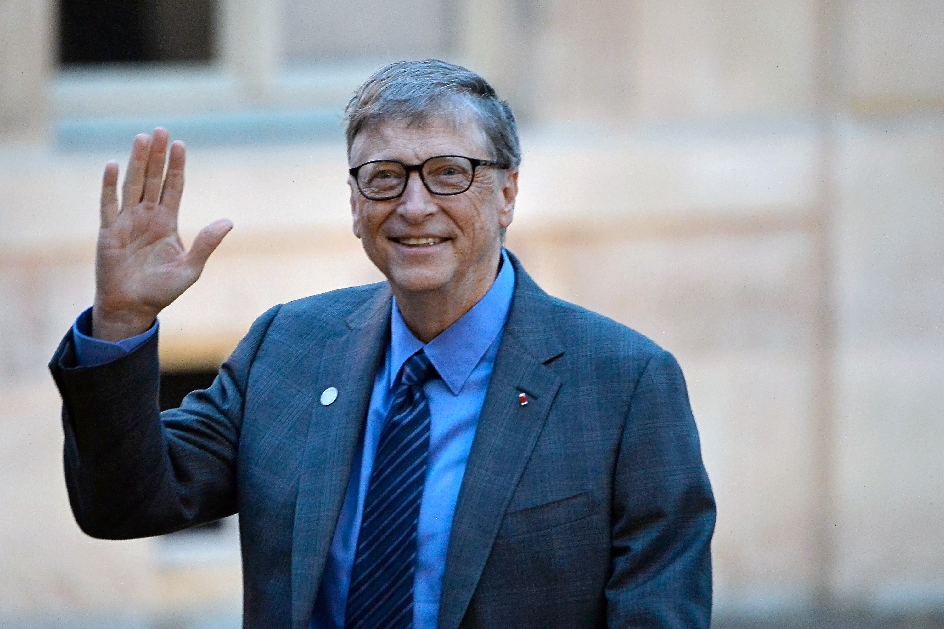 Bill Gates arrives for a meeting with French President Emmanuel Macron as he receives One Planet Summit's international philanthropists at Elysee Palace on December 12, 2017 in Paris, France.
