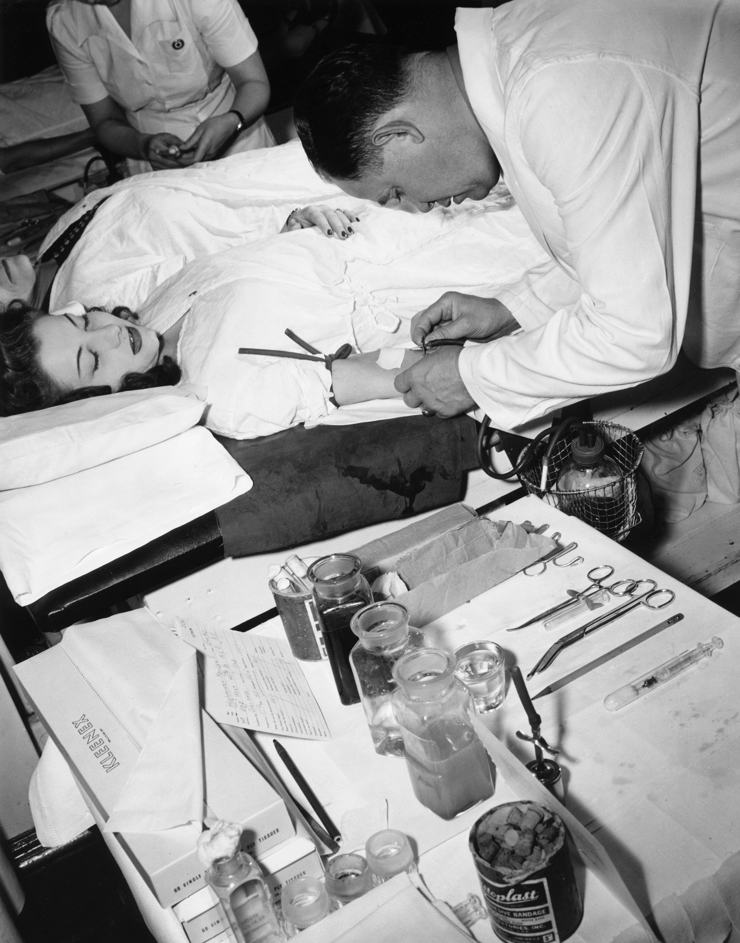 Woman donating blood to the Red Cross Blood Bank in New York City in 1943 during World War II.