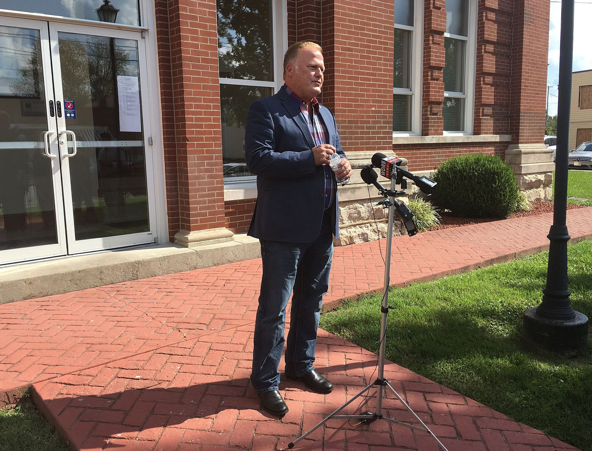 Kentucky state Rep. Dan Johnson speaks during a news conference outside the Bullitt County courthouse in Shepherdsville, Ky.