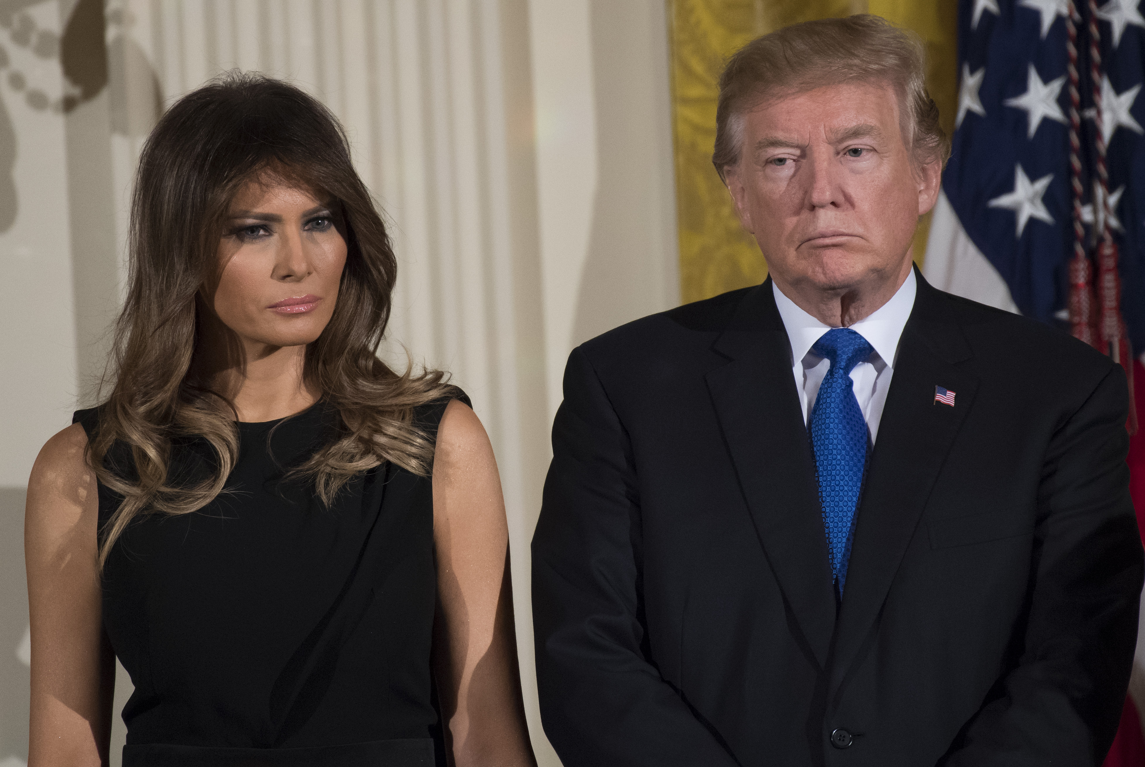 President Donald Trump and First Lady Melania Trump attend a Hanukkah reception in the East Room of the White House