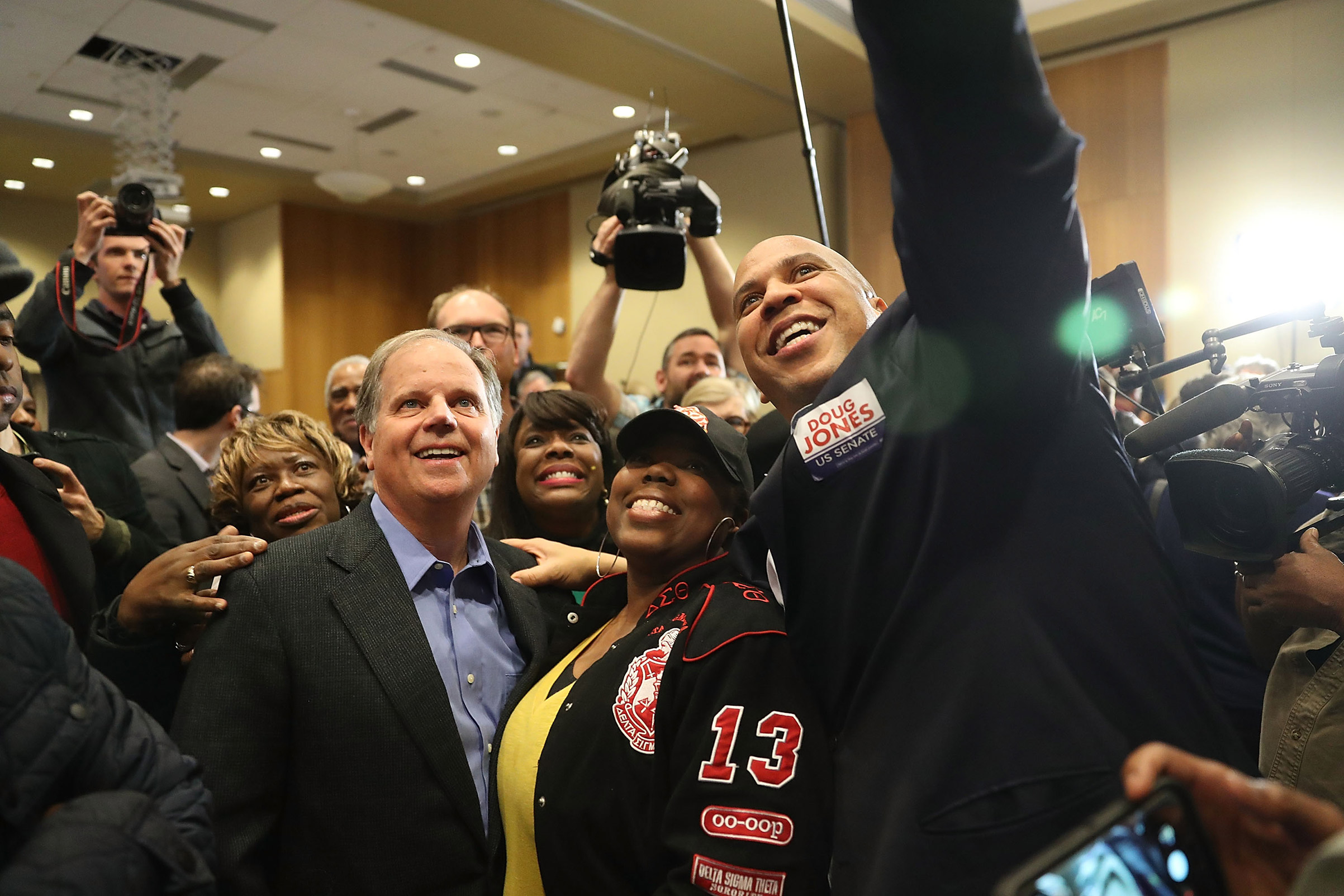 Democratic Senatorial candidate Doug Jones takes a group picture with Sen. Cory Booker (D-NJ) (R) and Rep. Terri Sewell (D-AL) (third from right) and supporters during a campaign event held at Alabama State University on December 9, 2017, in Montgomery, Alabama.