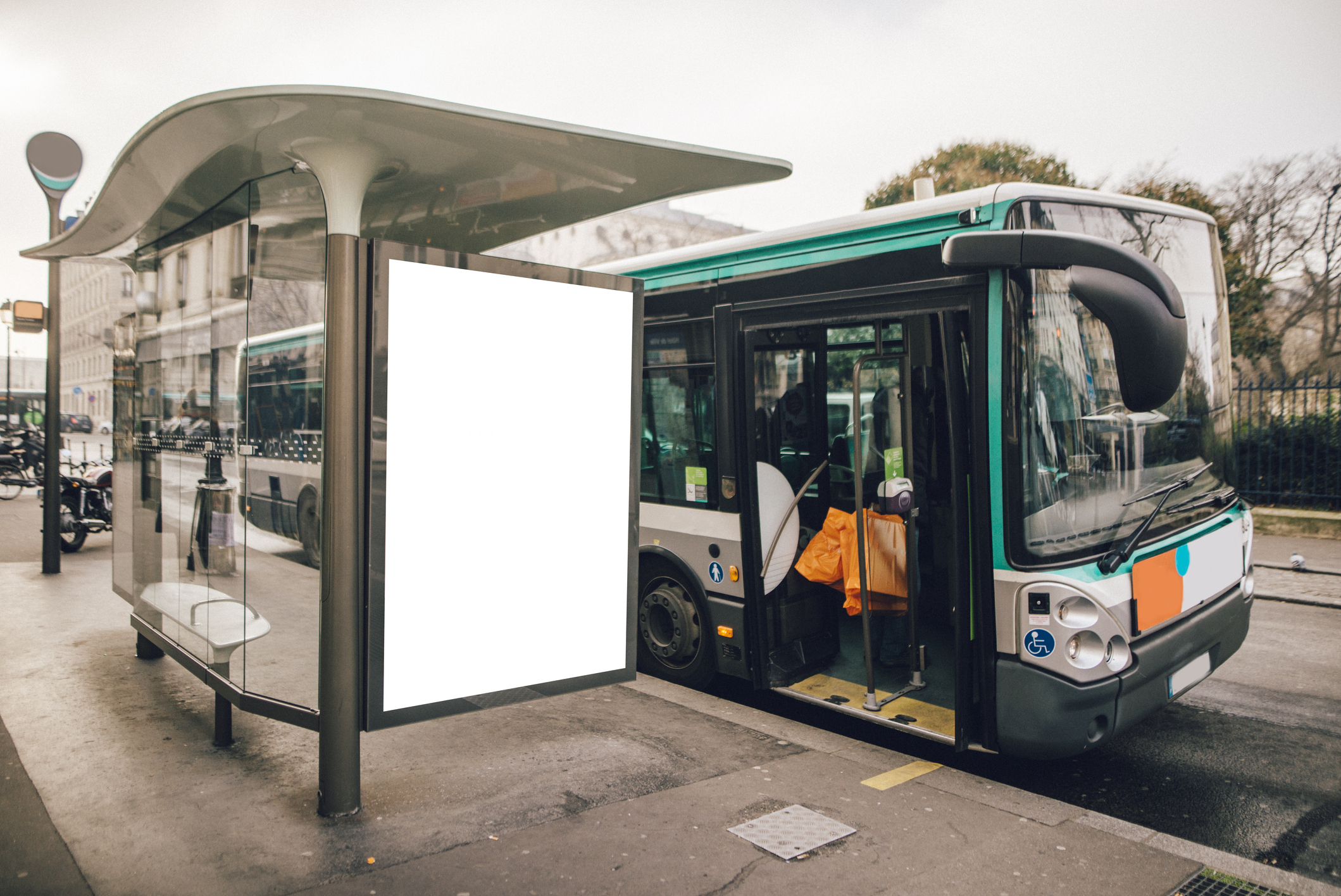 A bus stop with a blank billboard