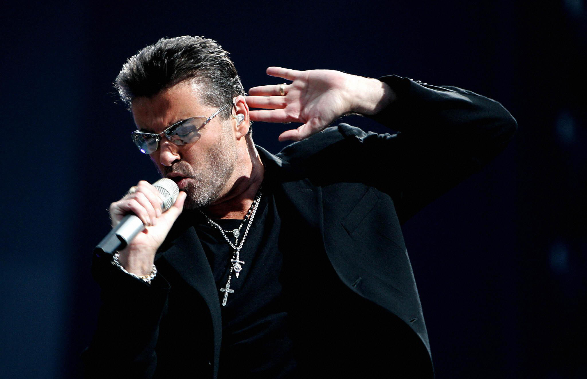 British singer George Michael performs during a concert in Amsterdam, 26 June 2007.