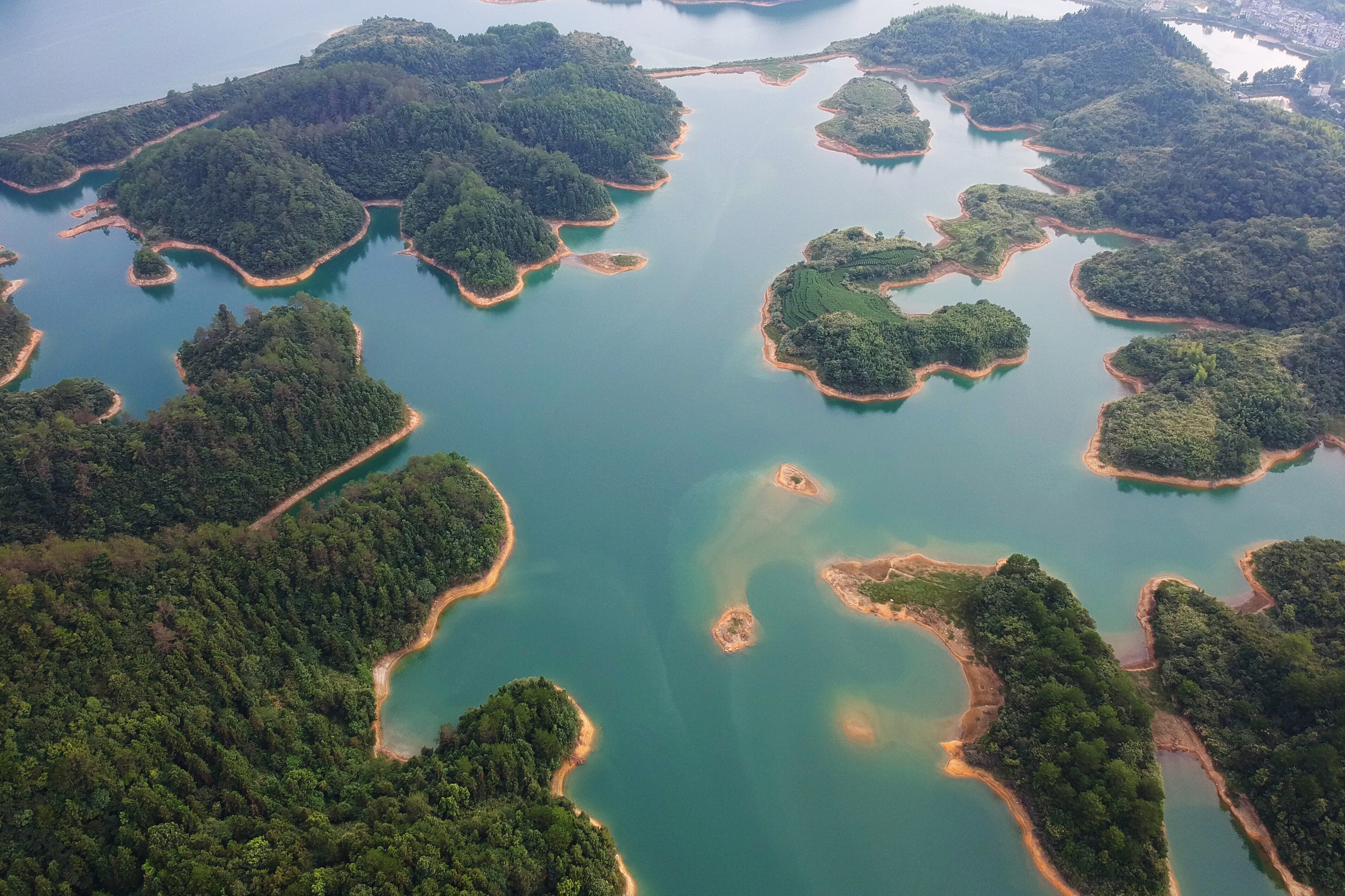 An aerial photo taken on Aug. 8, 2017 shows the scenery of Qiandao Lake in Chun'an County, east China's Zhejiang Province.