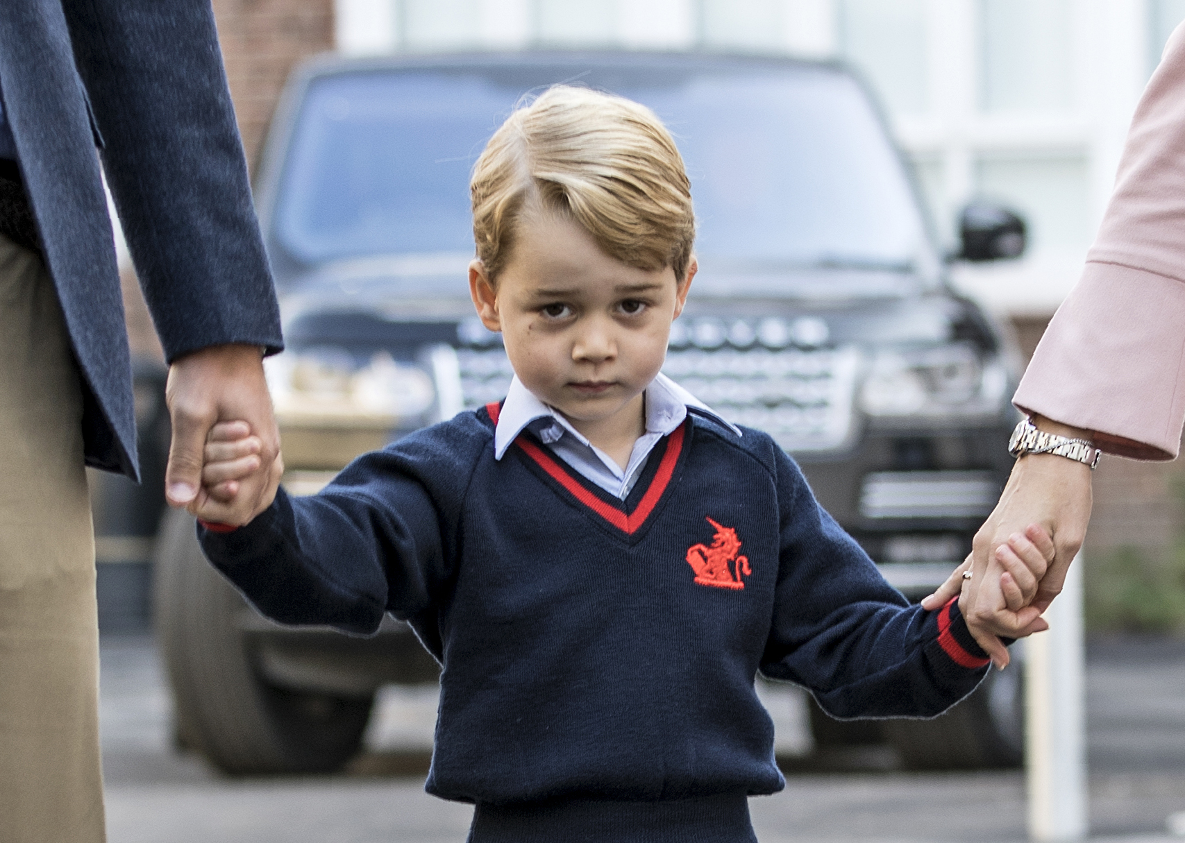 SEPT. 7 - Britain's Prince George (C) accompanied by Britain's Prince William (L), Duke of Cambridge arrives for his first day of school