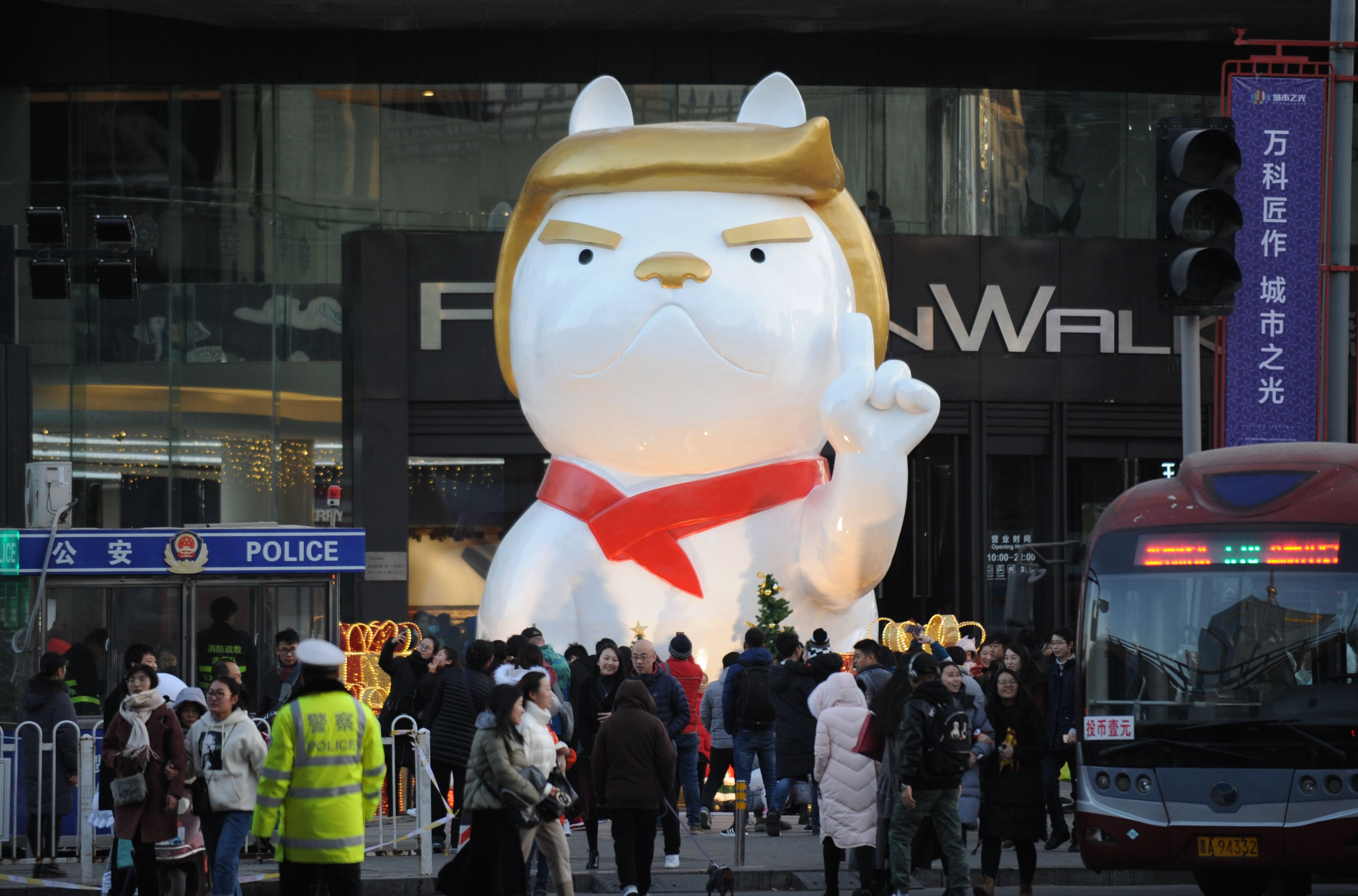 A dog sculpture resembling President Donald Trump outside a shopping mall in Taiyuan, China on on Dec. 24, 2017.