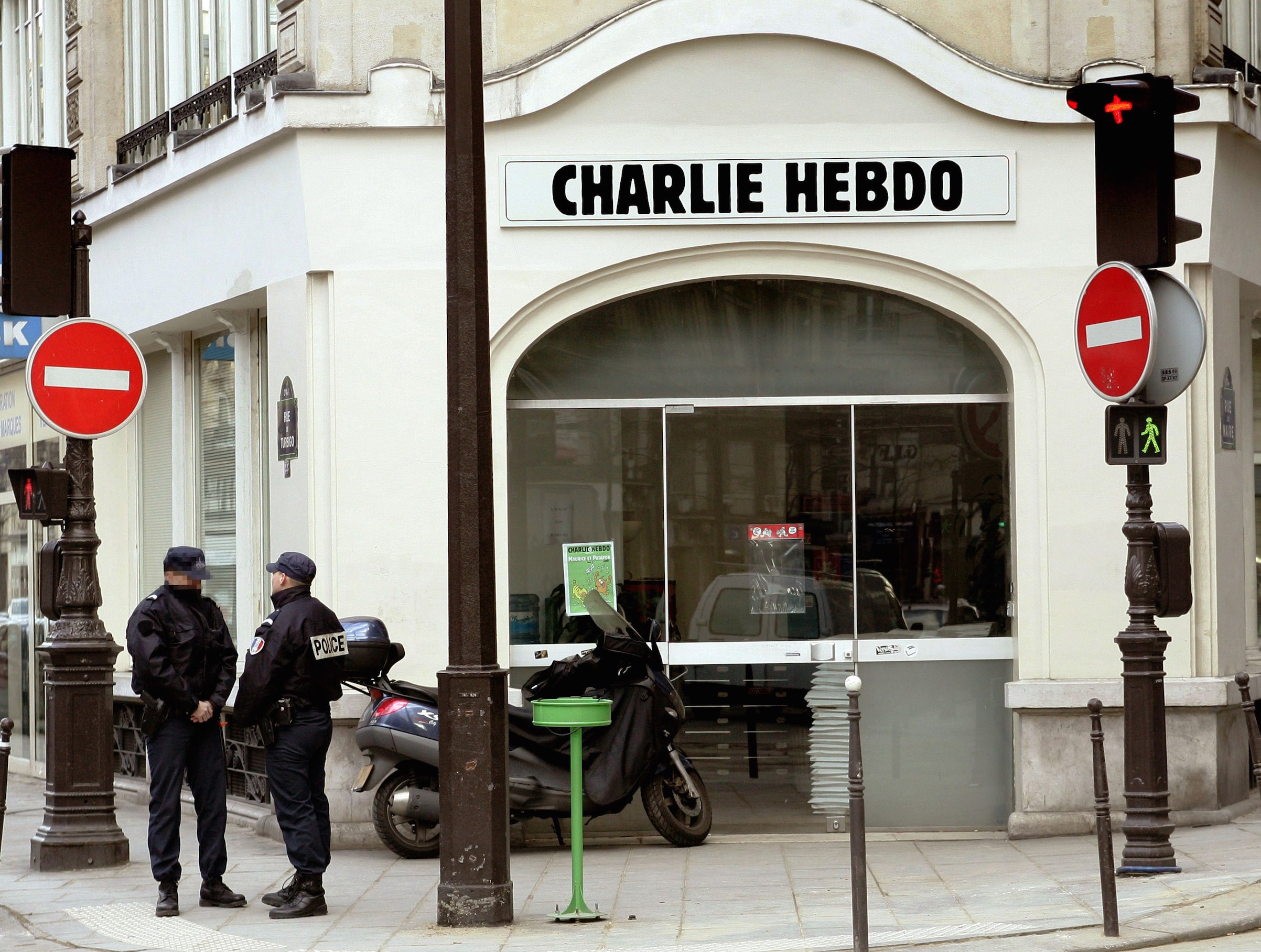 Policeman stand in front of the satirical French weekly Charlie Hebdo's headquarters, on Feb. 8, 2006, in Paris.