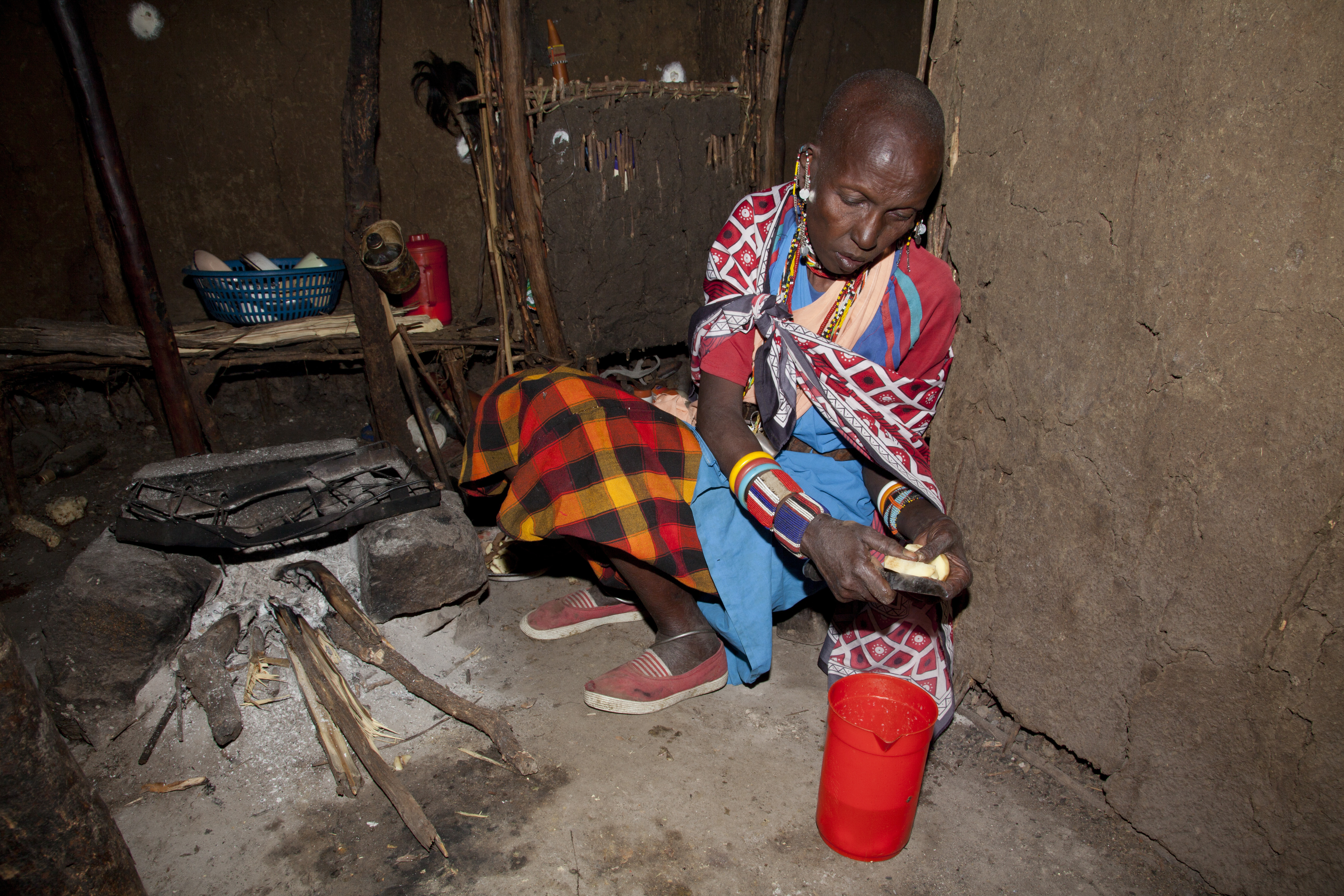 Masai wife of elder chief cooking in her hut in the village of Oliolomutia, next to the Masai Mara Nature Reserve, Kenya    (Photo by Julio Etchart/ullstein bild via Getty Images)