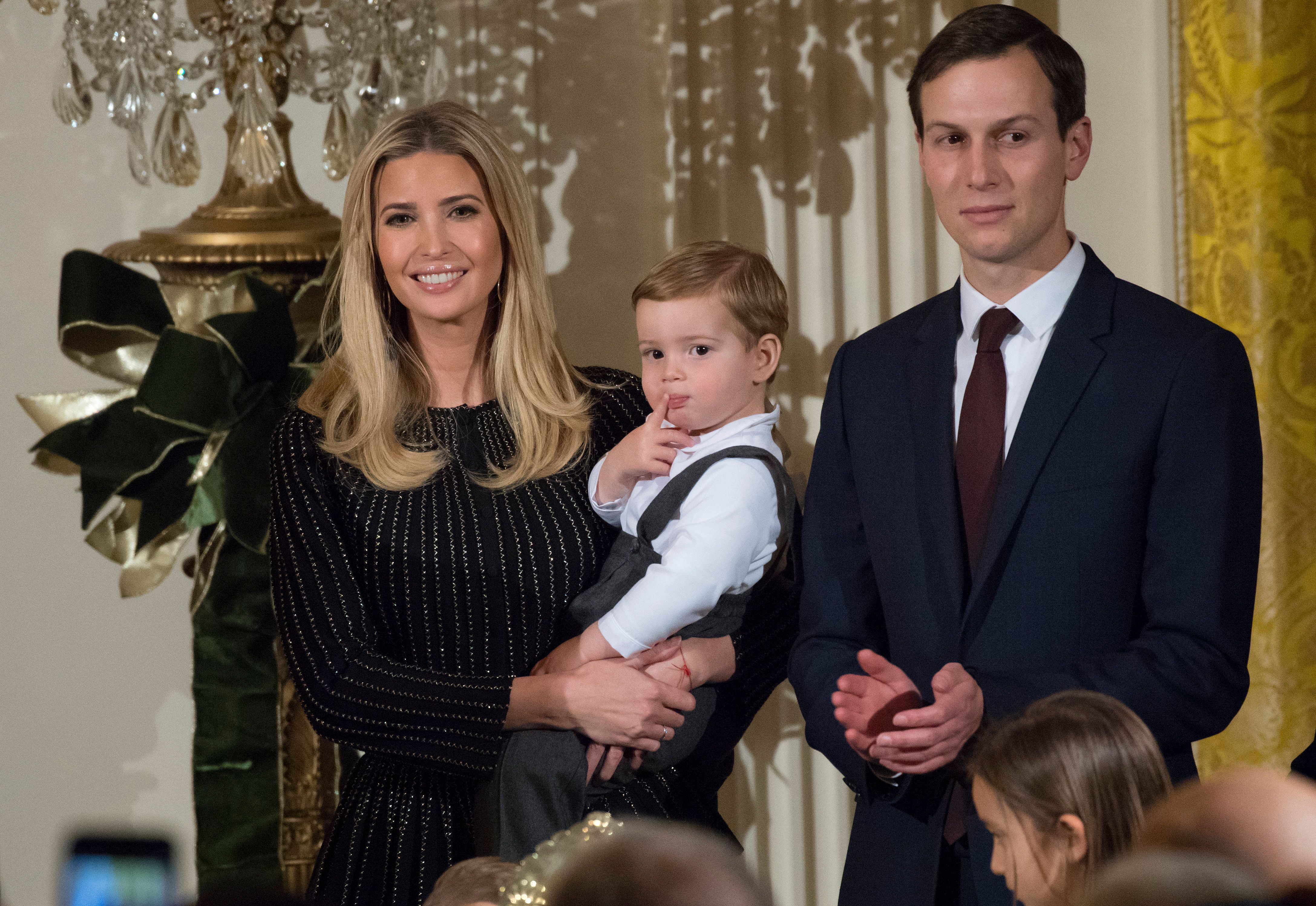 Ivanka Trump holds her son Theodore alongside Jared Kushner attends a Hanukkah reception