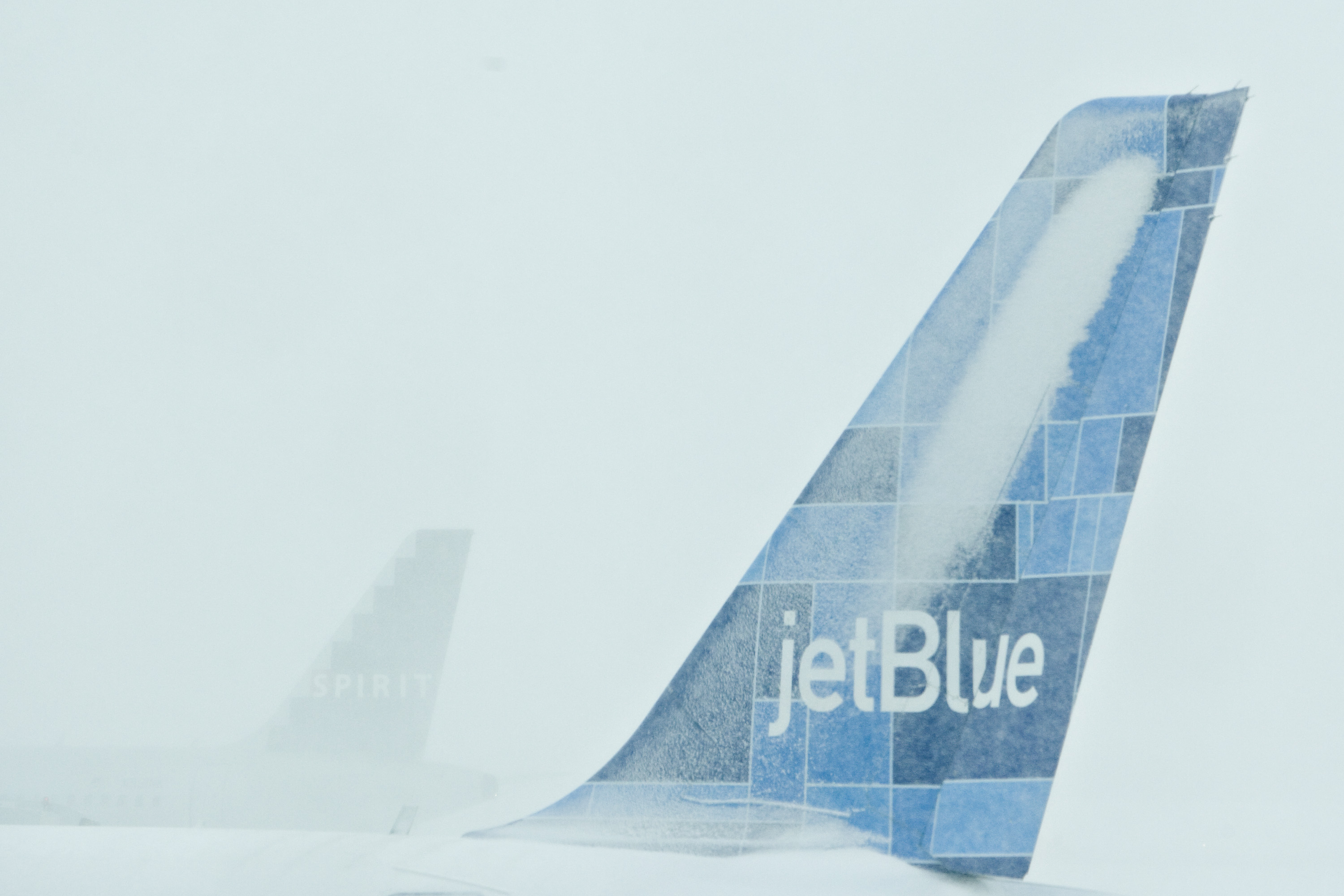 Snow covers the tail of a JetBlue Airbus at LaGuardia Airport in Queens, New York, on Feb. 10, 2010.