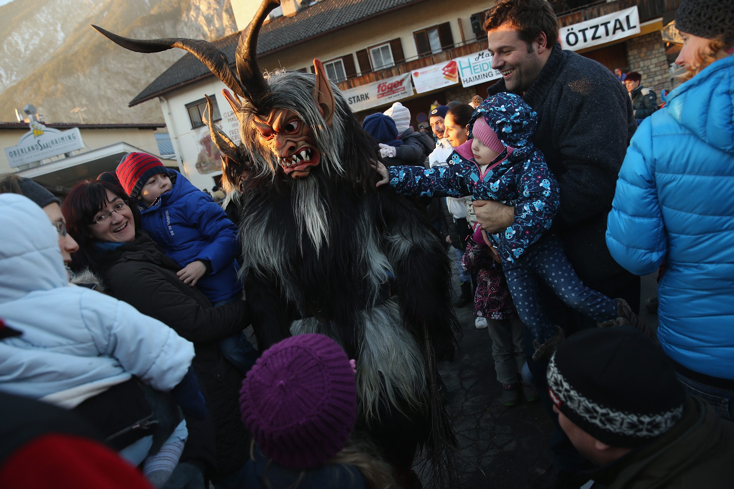 A member of the Haiminger Krampusgruppe dressed as the Krampus creature, an Austrian winter solstice ritual, lets himself be touched by onlookers prior to the annual Krampus night in Tyrol on Dec. 1, 2013.