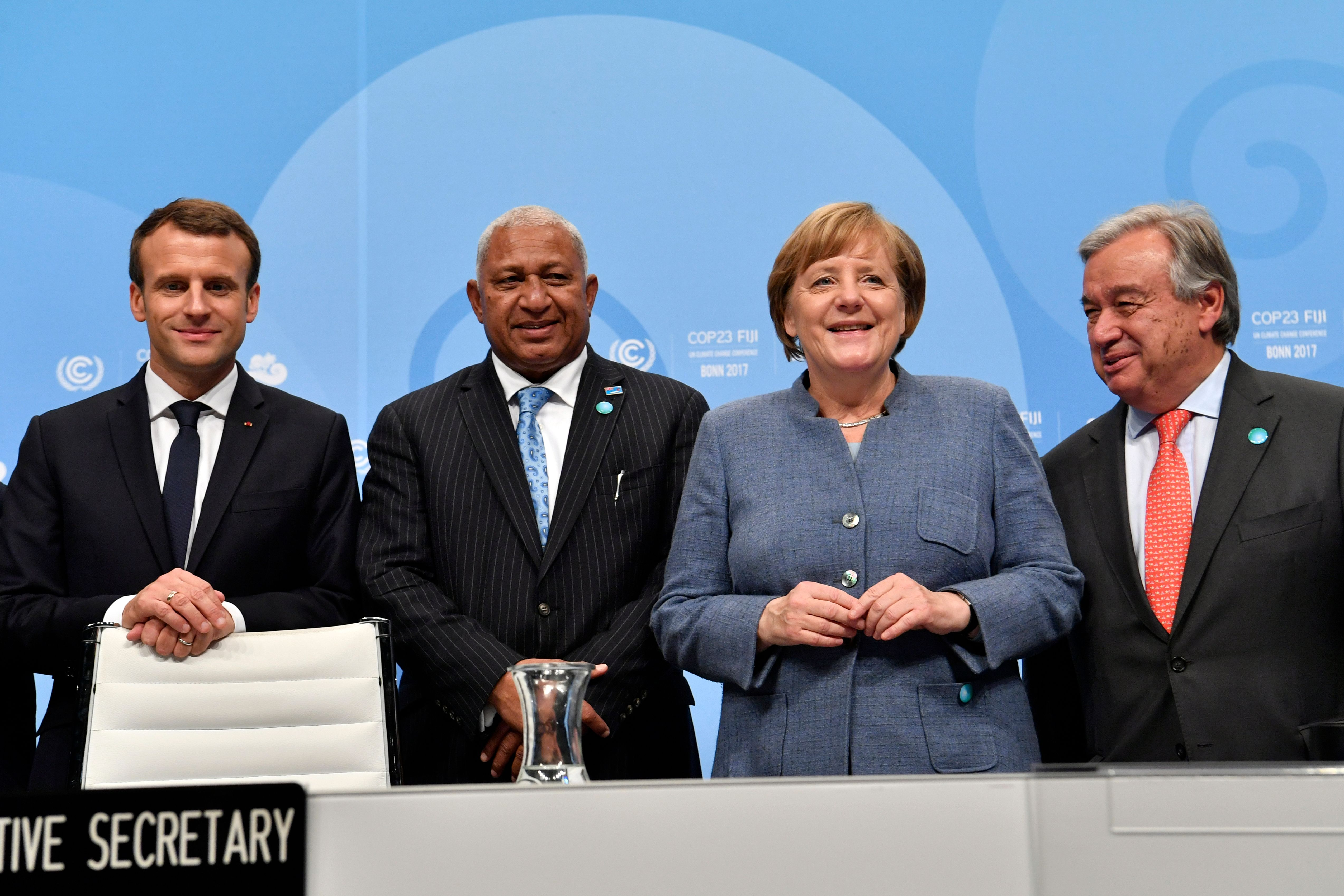 French President Emmanuel Macron, Prime Minister of Fiji Frank Bainimarama, German Chancellor Angela Merkel and UN Secretary-General Antonio Guterres pose before the opening session at the UN conference on climate change on Nov. 15 in Bonn