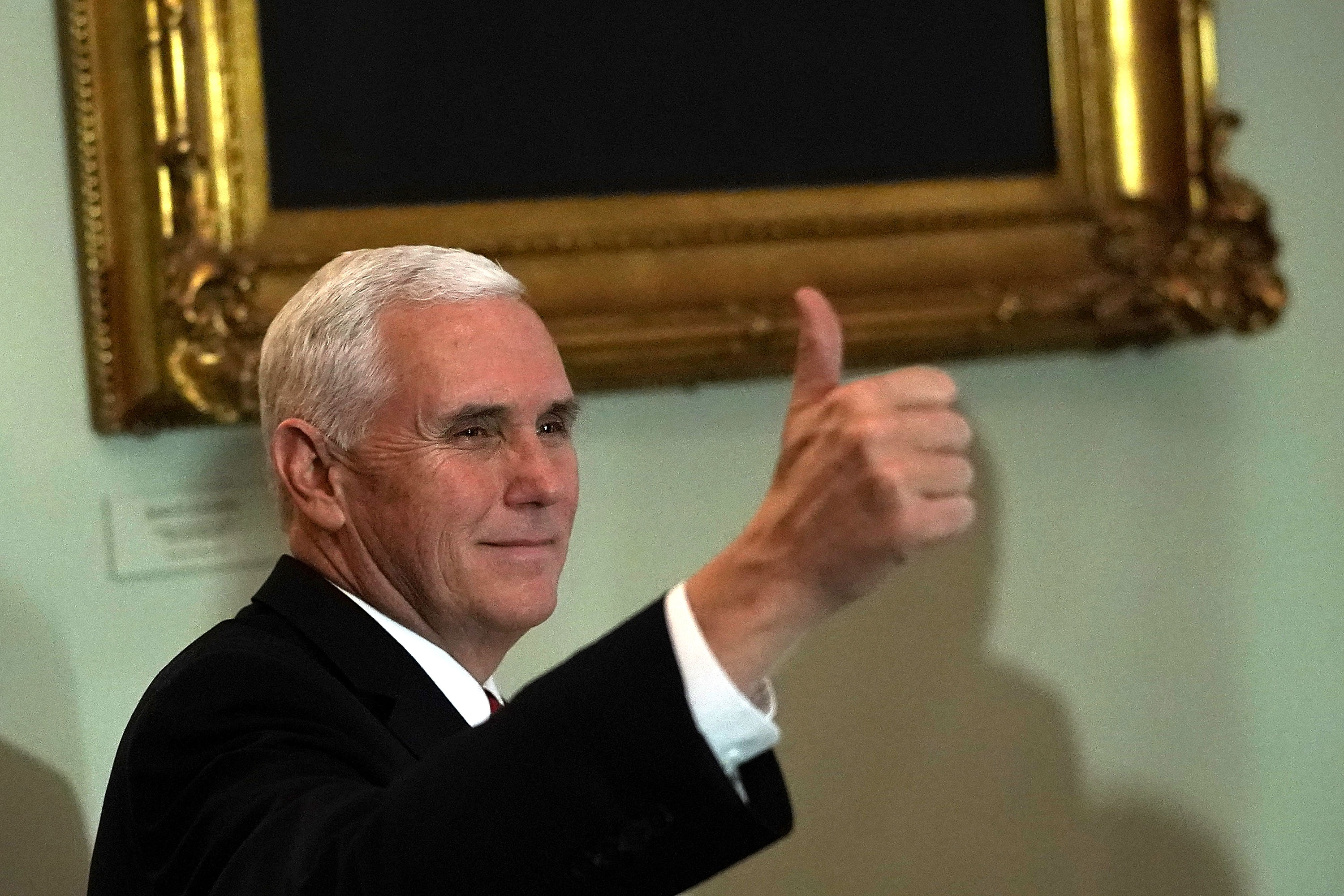 U.S. Vice President Mike Pence gives a thumbs up as he arrives for a Senate Republican policy luncheon at the Capitol December 19, 2017 in Washington, DC. The Senate is expected to vote on the tax bill once the House passed it.