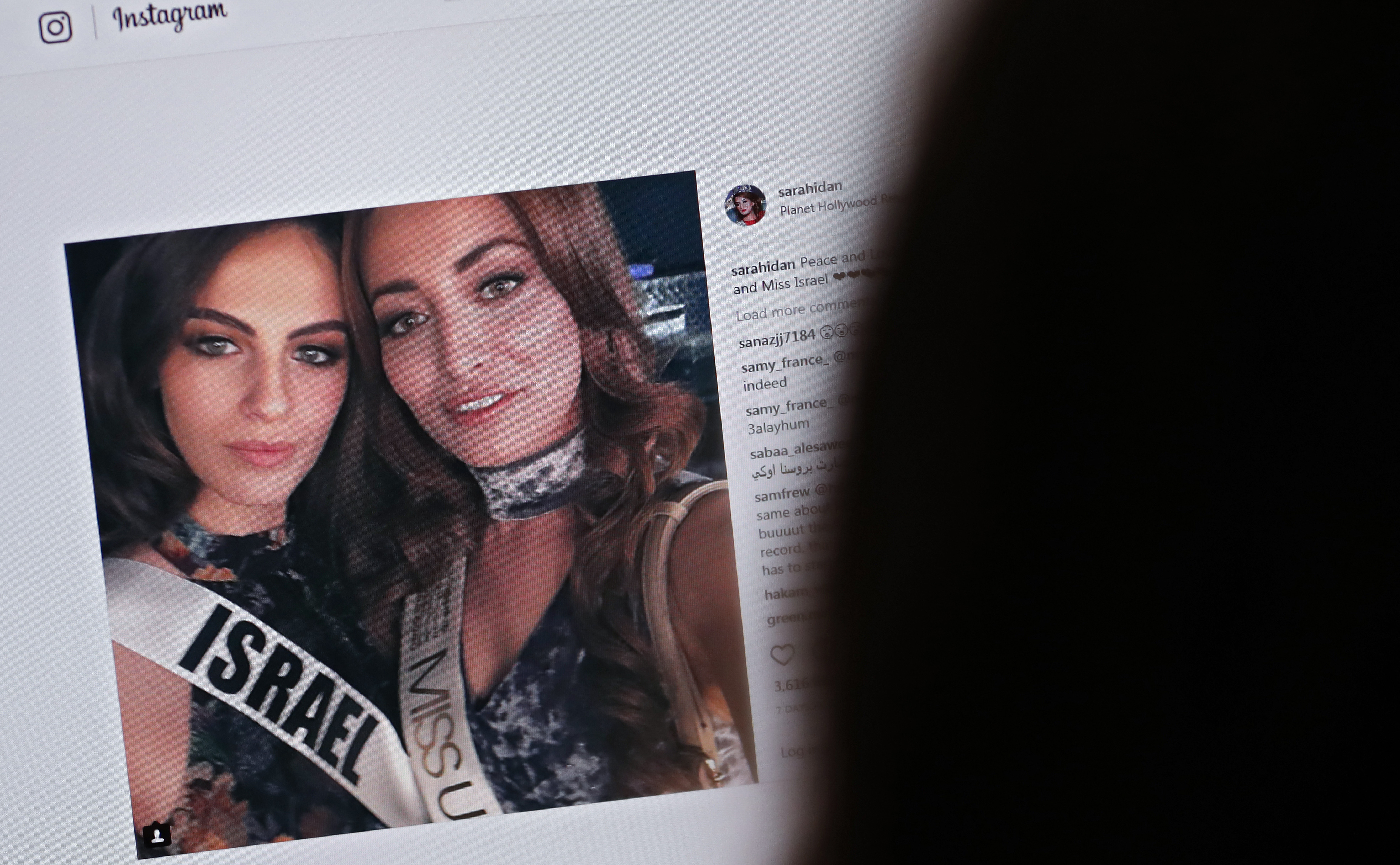 A picture taken on November 21, 2017 shows a picture posted by the Instagram profile of Sarah Idan on November 14, who holds the titles of  Miss Iraq USA 2016  and  Miss Iraq Universe 2017 , as she is seen taking a  selfie  photograph with Adar Gandelsman, who holds the title of  Miss Universe Israel 2017 , with a caption reading:  Peace and Love from Miss Iraq and Miss Israel #missuniverse .