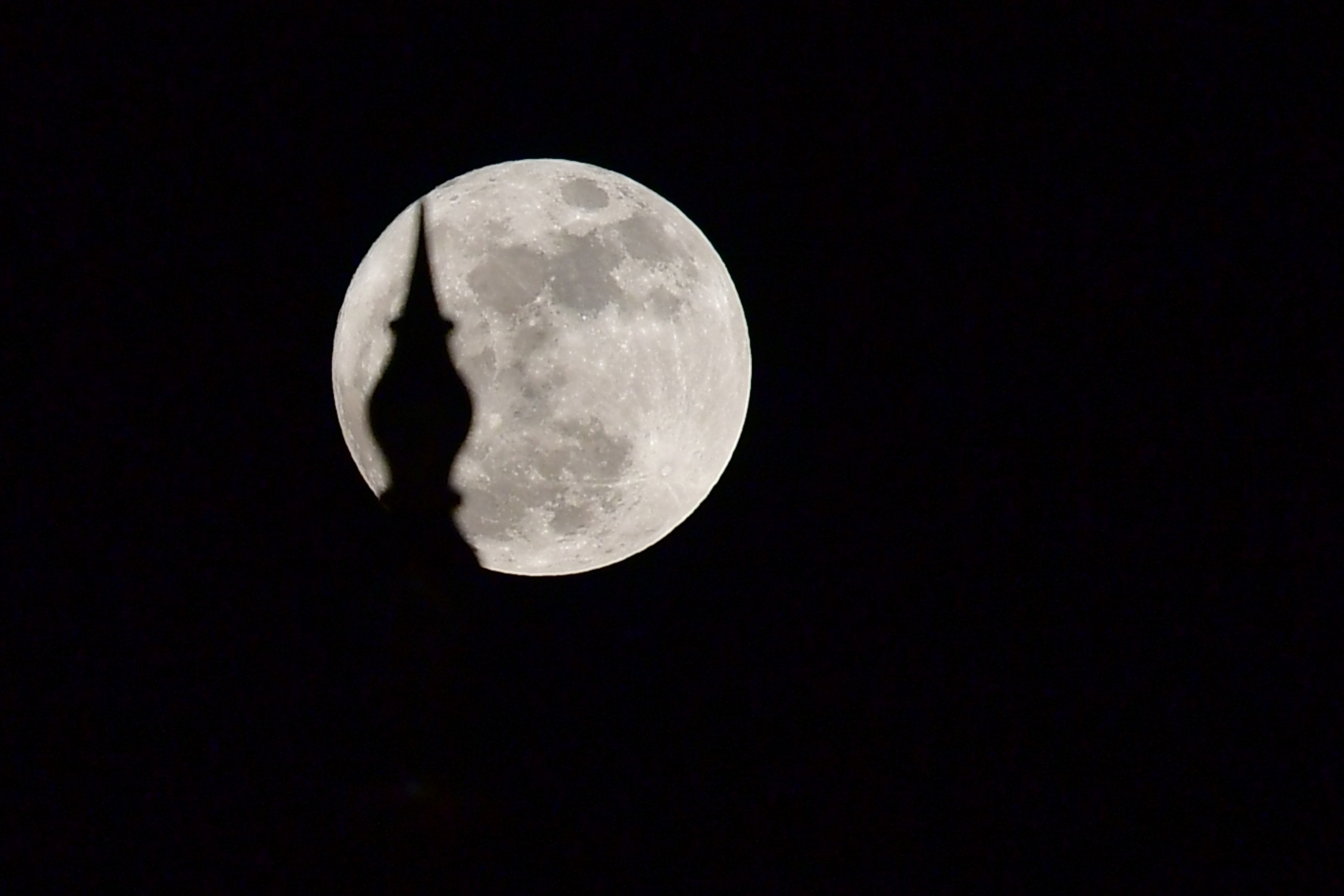 A picture taken on Dec. 3, 2017 shows a  supermoon  rising over the Sheikh Zayed Grand Mosque in the UAE capital Abu Dhabi.