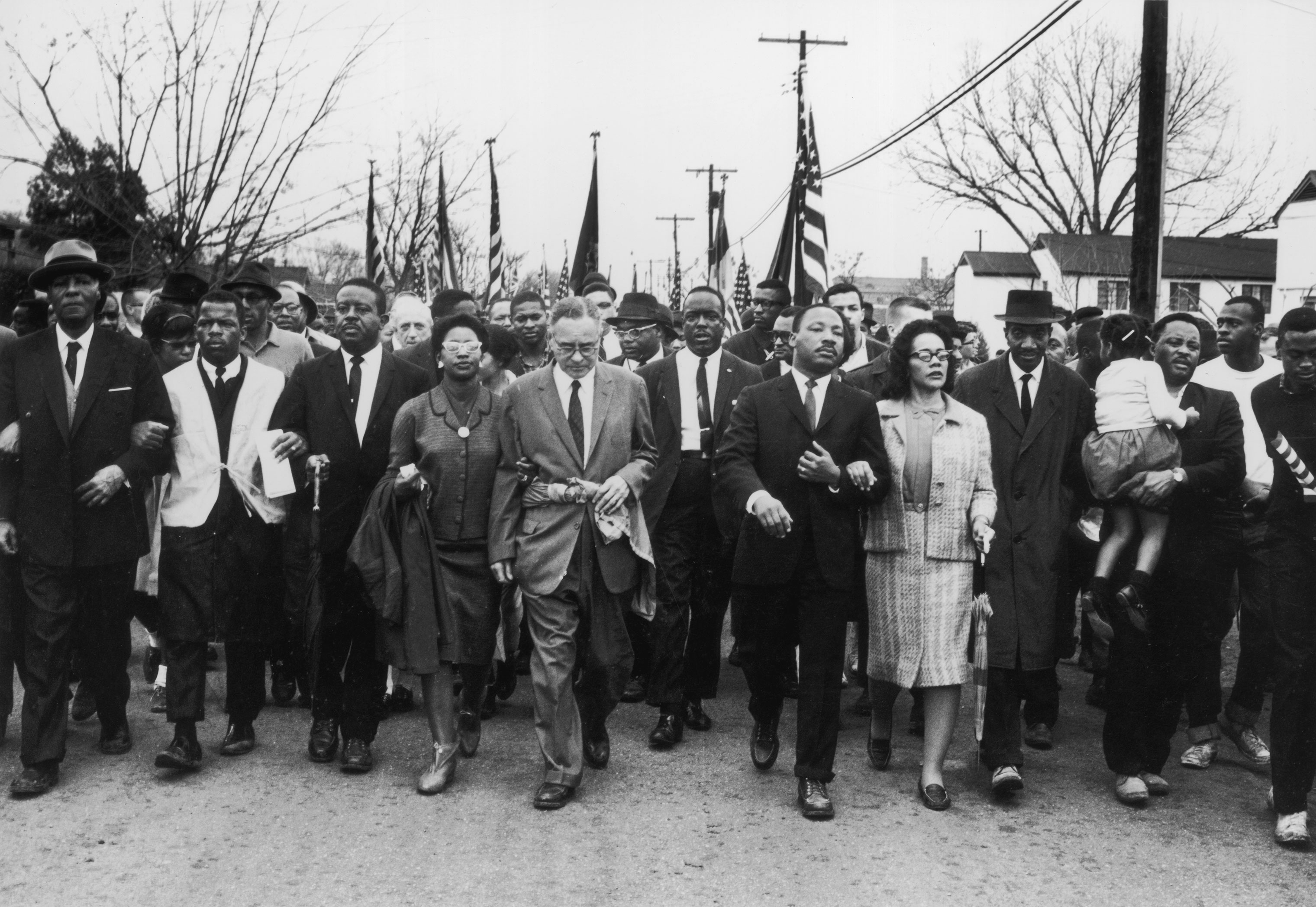 John Lewis (second from left) joins American civil rights campaigner Martin Luther King Jr. and his wife Coretta Scott King in a march from Selma, Alabama, to the state capital in Montgomery, March 30, 1965.