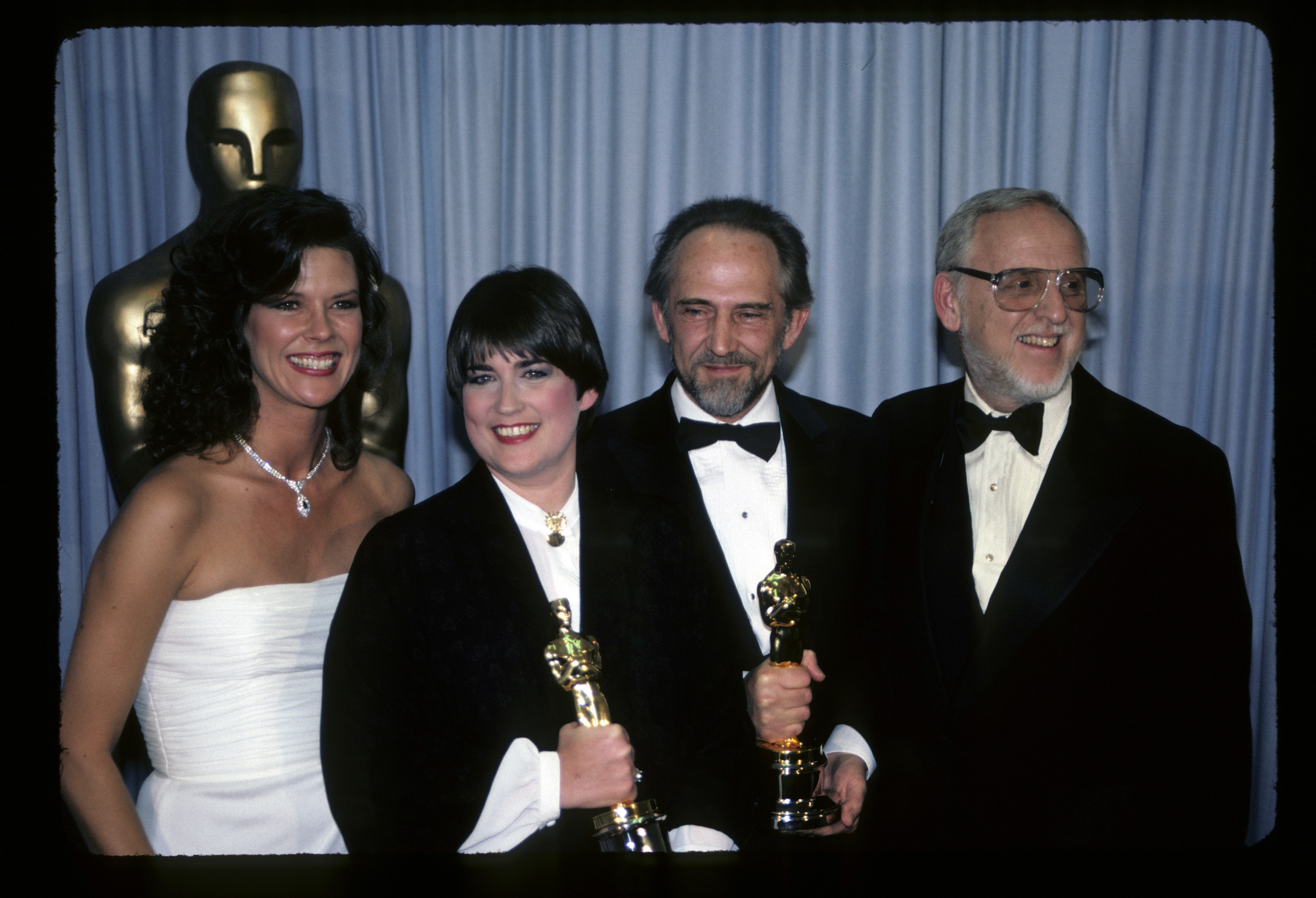 Director Terre Nash (2nd from L) and producer Edward le Lorrain (2nd from R) after winning an Oscar for 'If You Love This Planet' in 1983