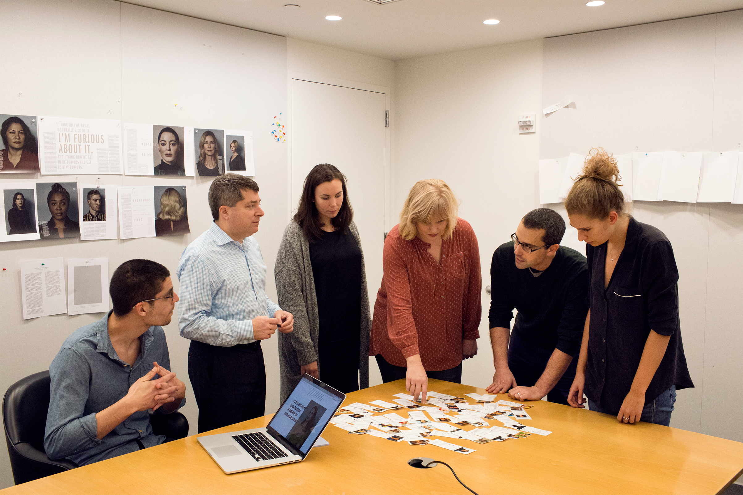 """From left: senior engineer David Kofahl, editor-in-chief Edward Felsenthal, senior producer Tara Johnson, associate art director Chelsea Kardokus, assistant managing editor Ben Goldberger and writer Eliana Dockterman outlining the package in their second home, a secret conference room called """"the bunker."""""""