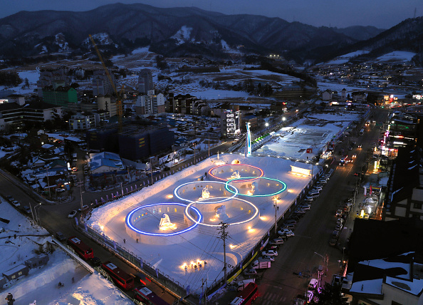 The Olympic Rings are illuminated in PyeongChang. The Asahi Shimbun via Getty Images.