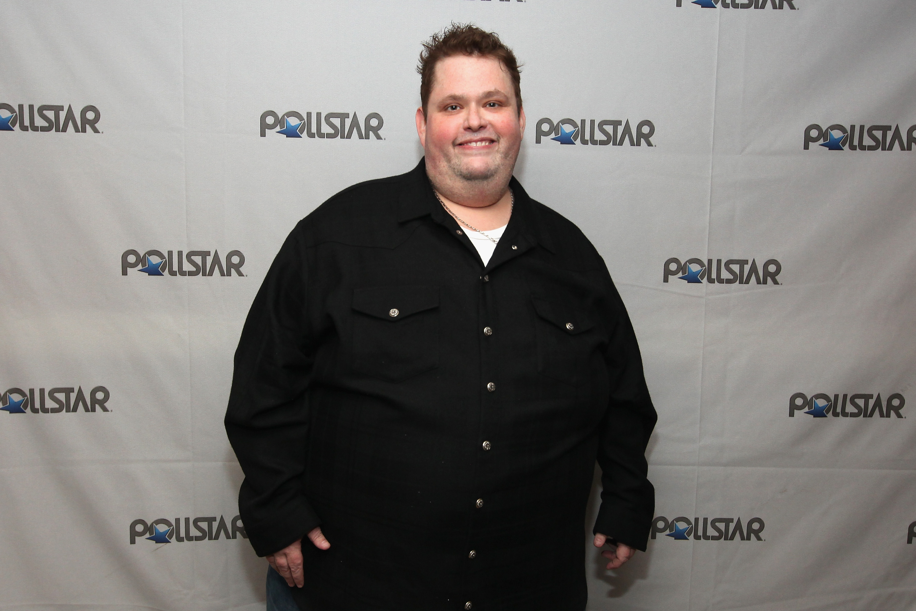 Host Ralphie May poses backstage during the 26th Annual PollStar Awards at Ryman Auditorium on February 21, 2015 in Nashville, Tennessee.