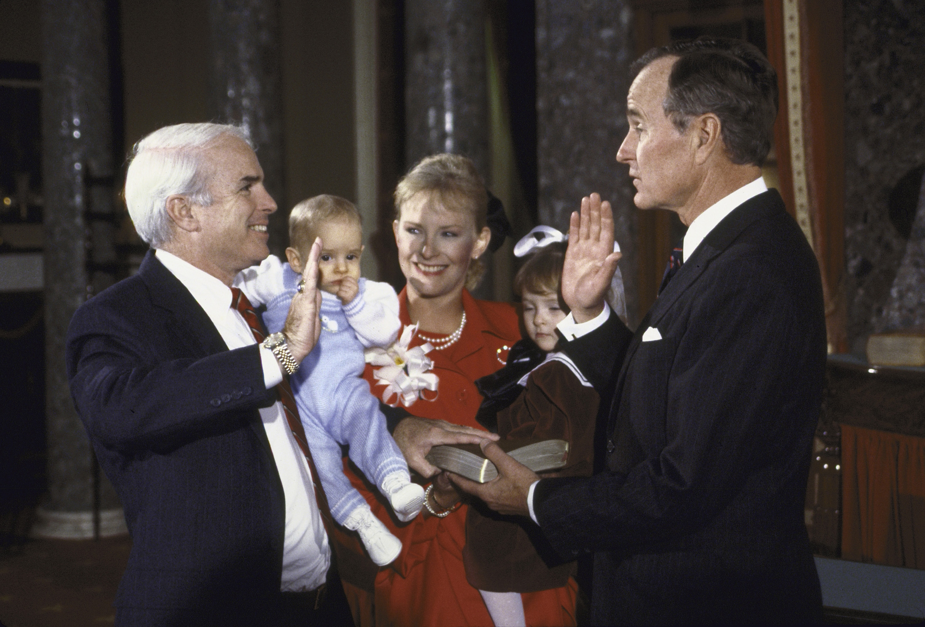Vice President George H.W. Bush re-enacting Senate Swear-In with Sen. John S. McCain and his family.