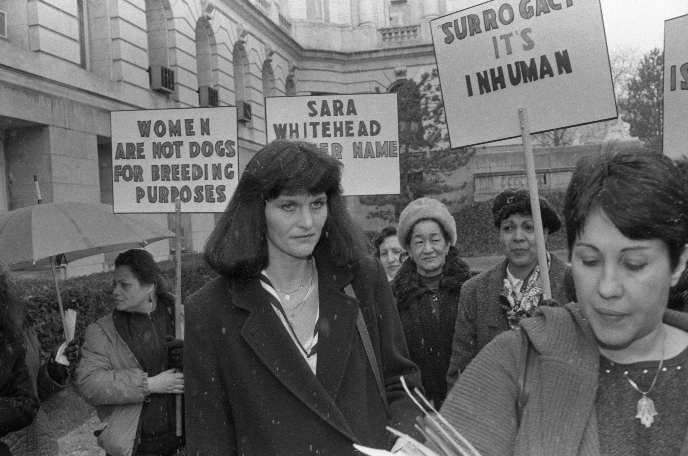 Surrogate mother Mary Beth Whitehead joins a group of women demonstrating on her behalf outside Bergen County courthouse on March 12, 1987, after the lawyers in the  Baby M  custody case delivered their summations.