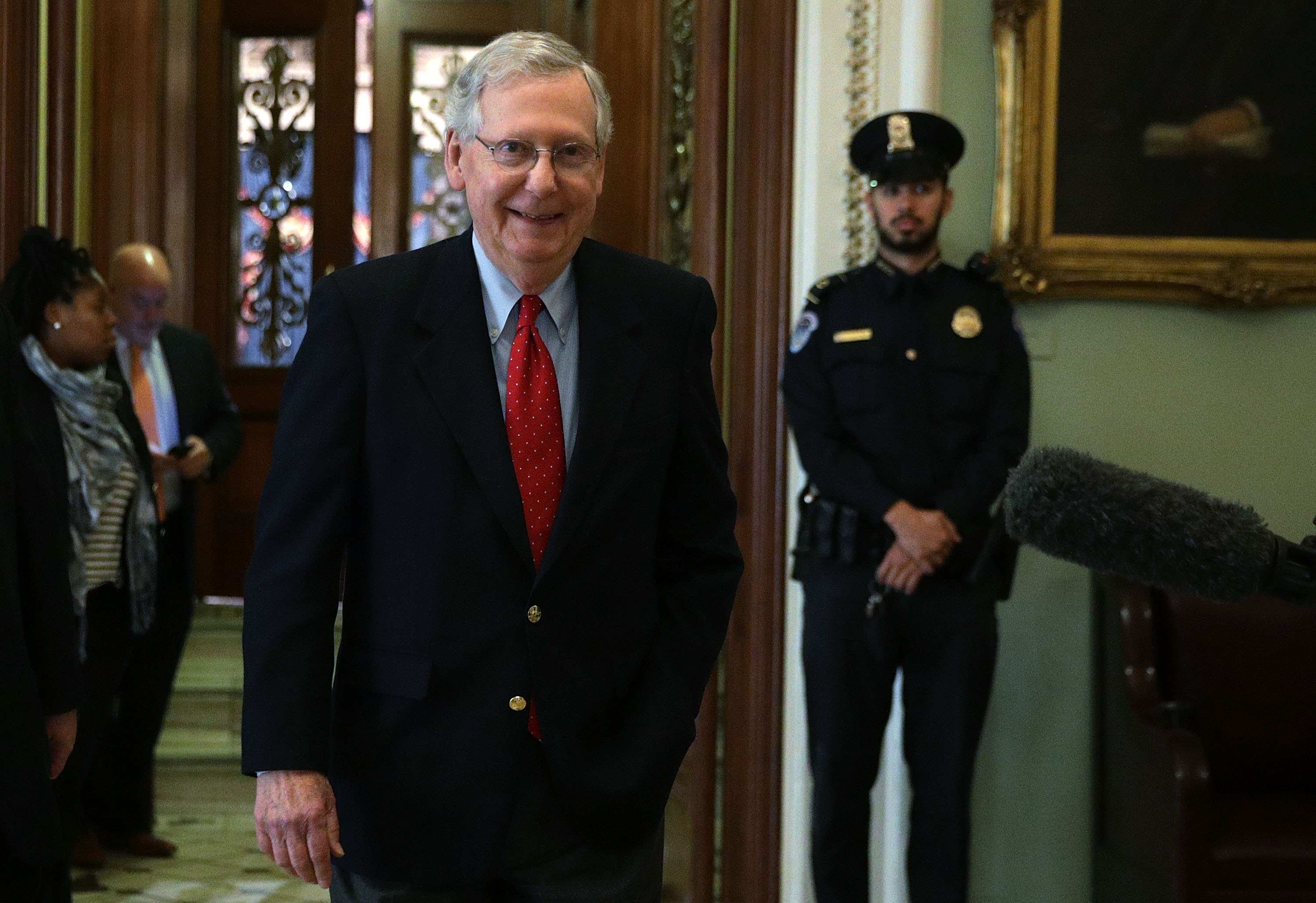 WASHINGTON, DC - DECEMBER 01:  U.S. Senate Majority Leader Sen. Mitch McConnell (R-KY) walks from the Senate chamber to his office December 1, 2017 at the Capitol in Washington, DC. Senate GOPs indicate that they have enough votes to pass the tax reform bill.  (Photo by Alex Wong/Getty Images)