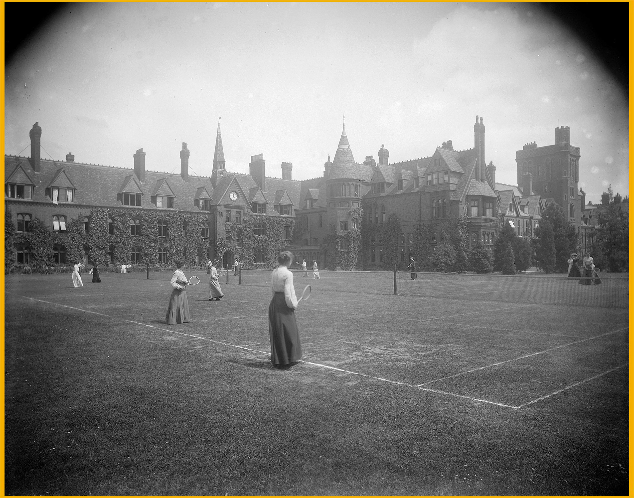 Female undergraduates playing tennis in the grounds of Girton College at Cambridge University, circa 1900.